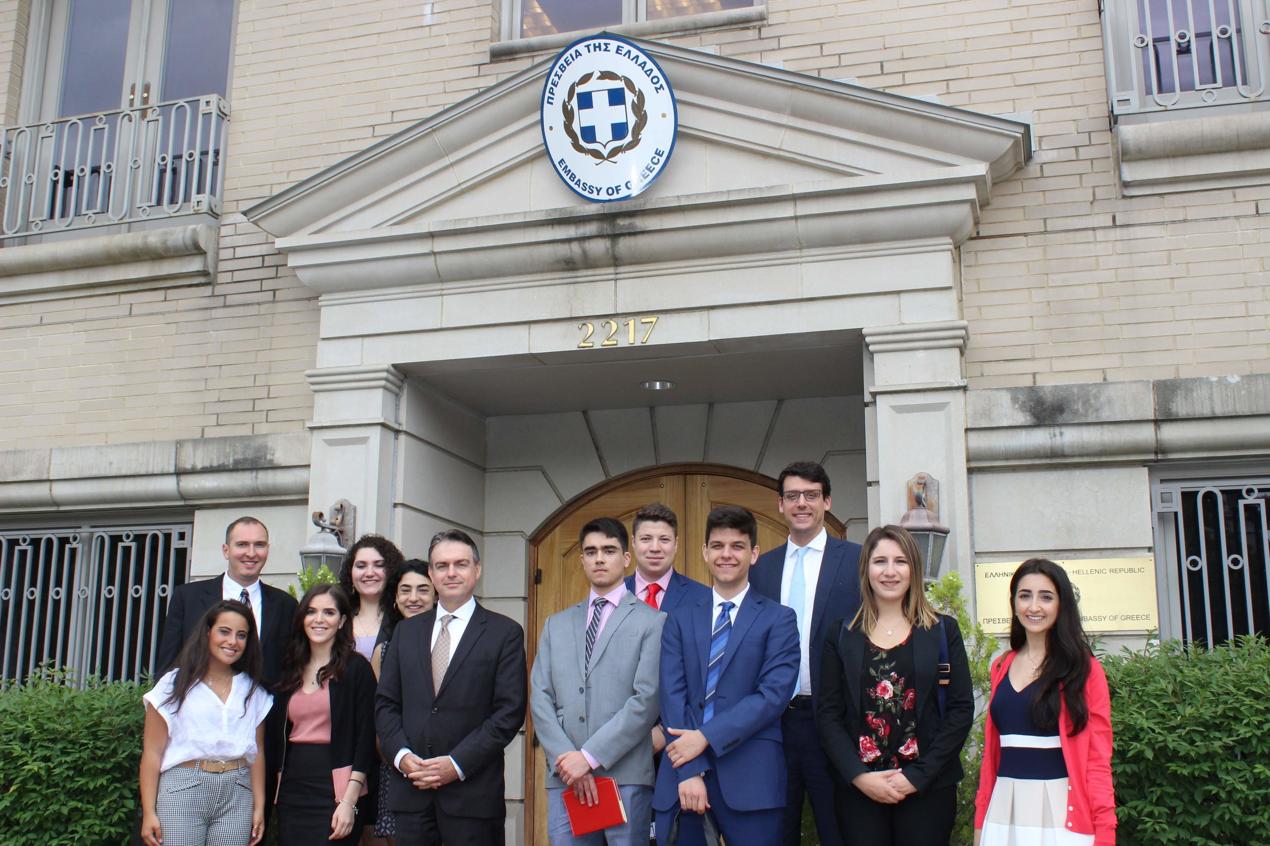 Alexios Mitsopoulos, deputy chief of mission at the Greek Embassy with students outside of the Embassy of Greece.
