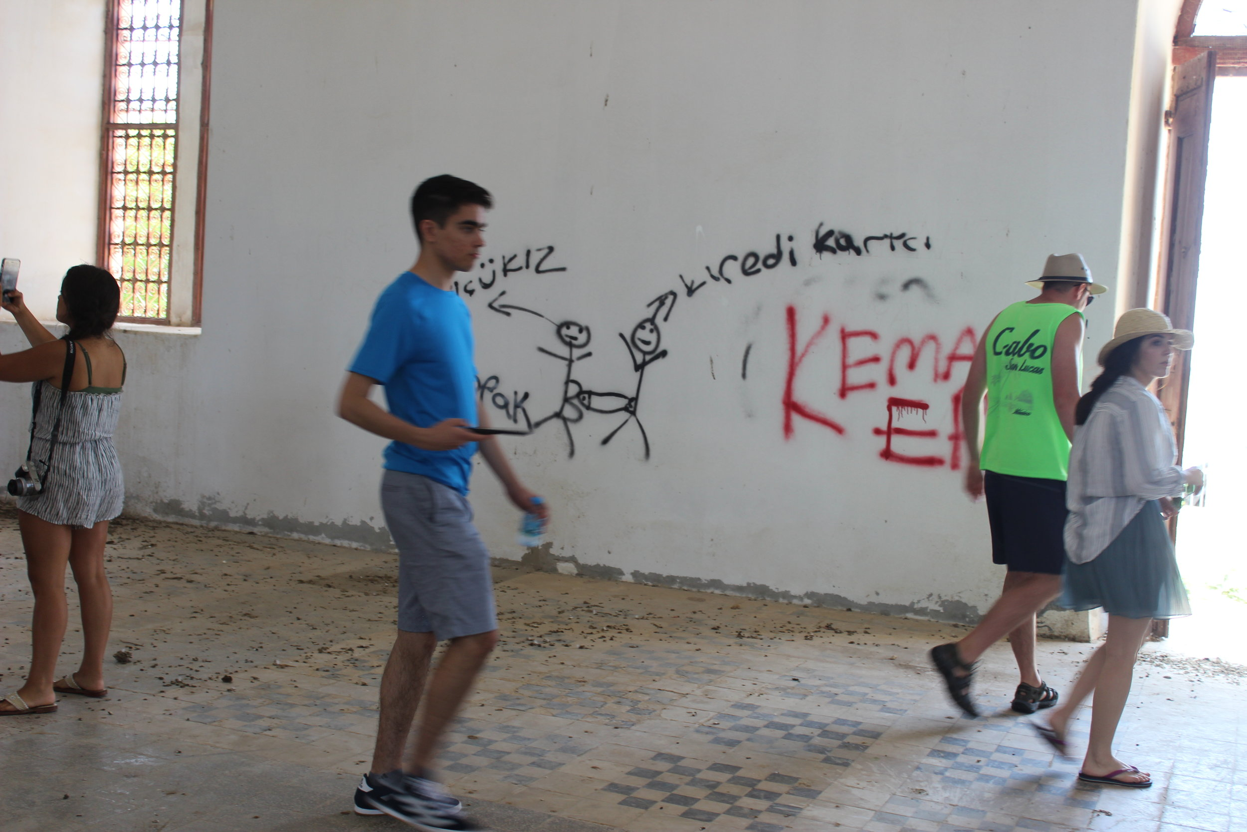 AHIF students at a desecrated church located in Cyprus' illegally occupied area.