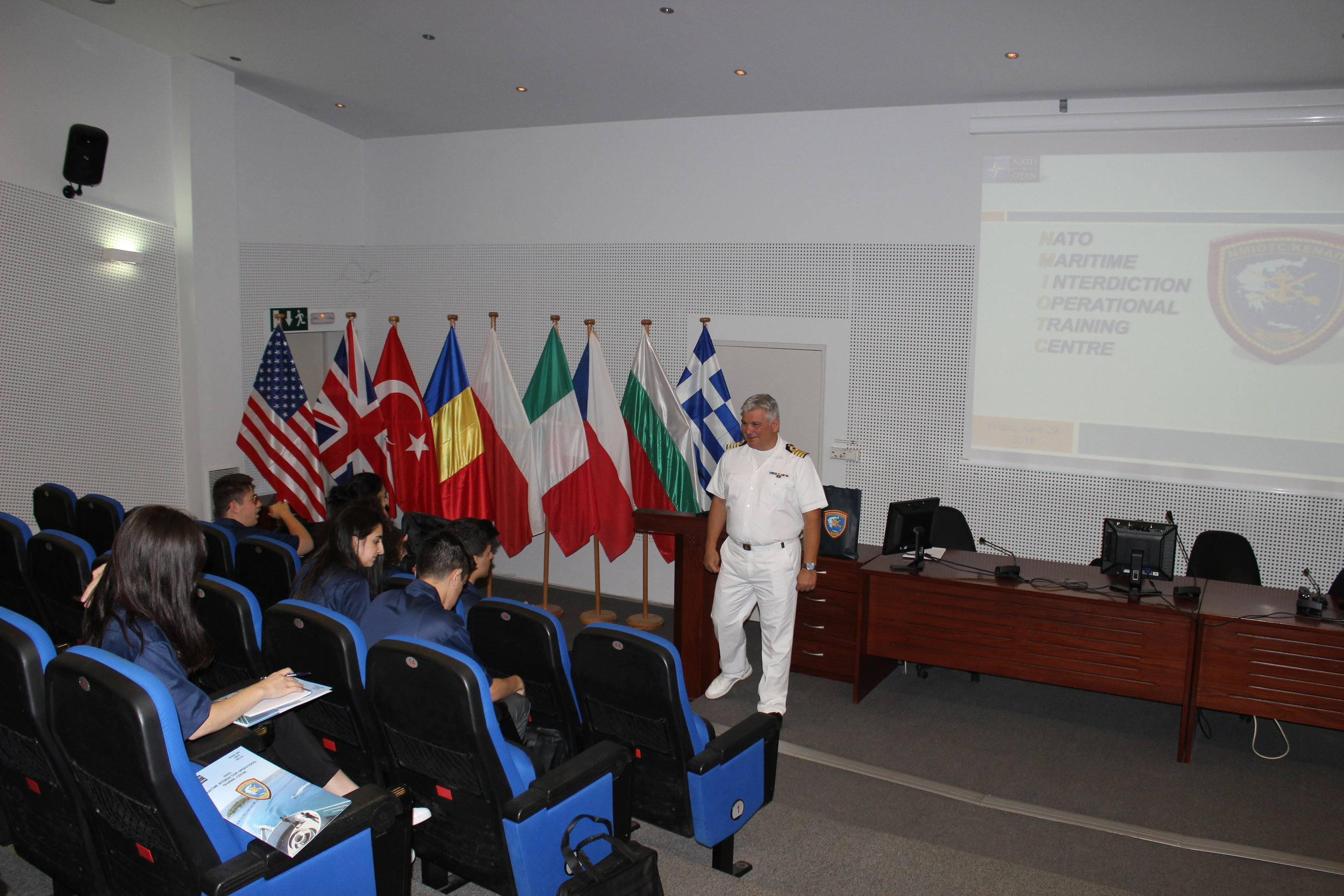 Briefing on NATO maritime interdiction training at NMIOTC.