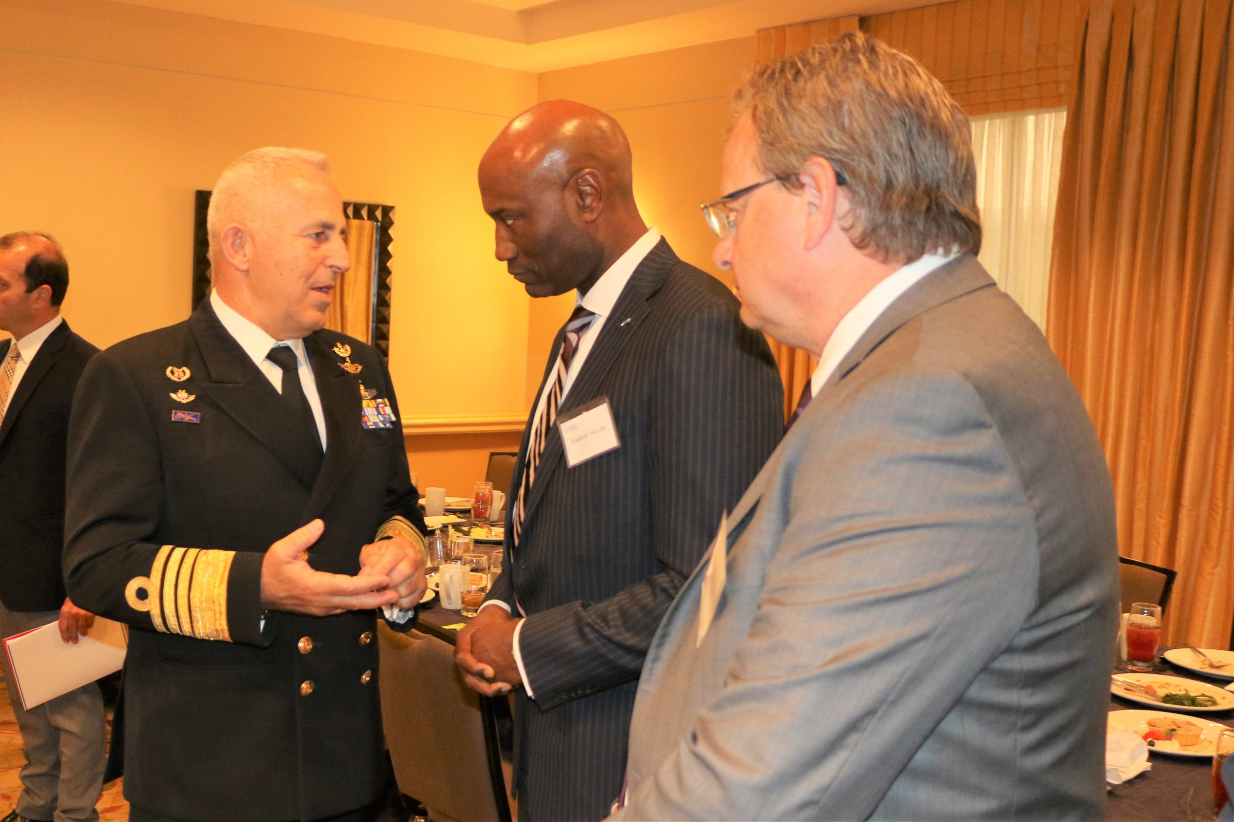 Chief of Hellenic Armed Forces, Admiral Evangelos Apostolakis, chats with representatives from Lockheed Martin Aeronautics at high-level policy luncheon co-hosted by AHI & Lexington Institute.