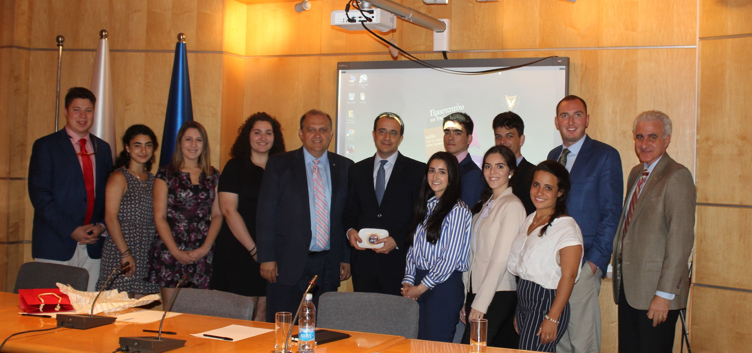 Students pose with Foreign Minister Nikos Christodoulides (center) and Director of Middle East and North Africa Directorate, Andreas Kakouris (far right).