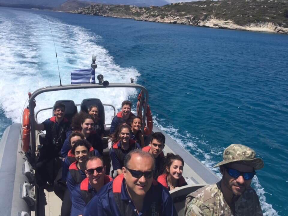 Students touring Souda Bay on a skiff boat.