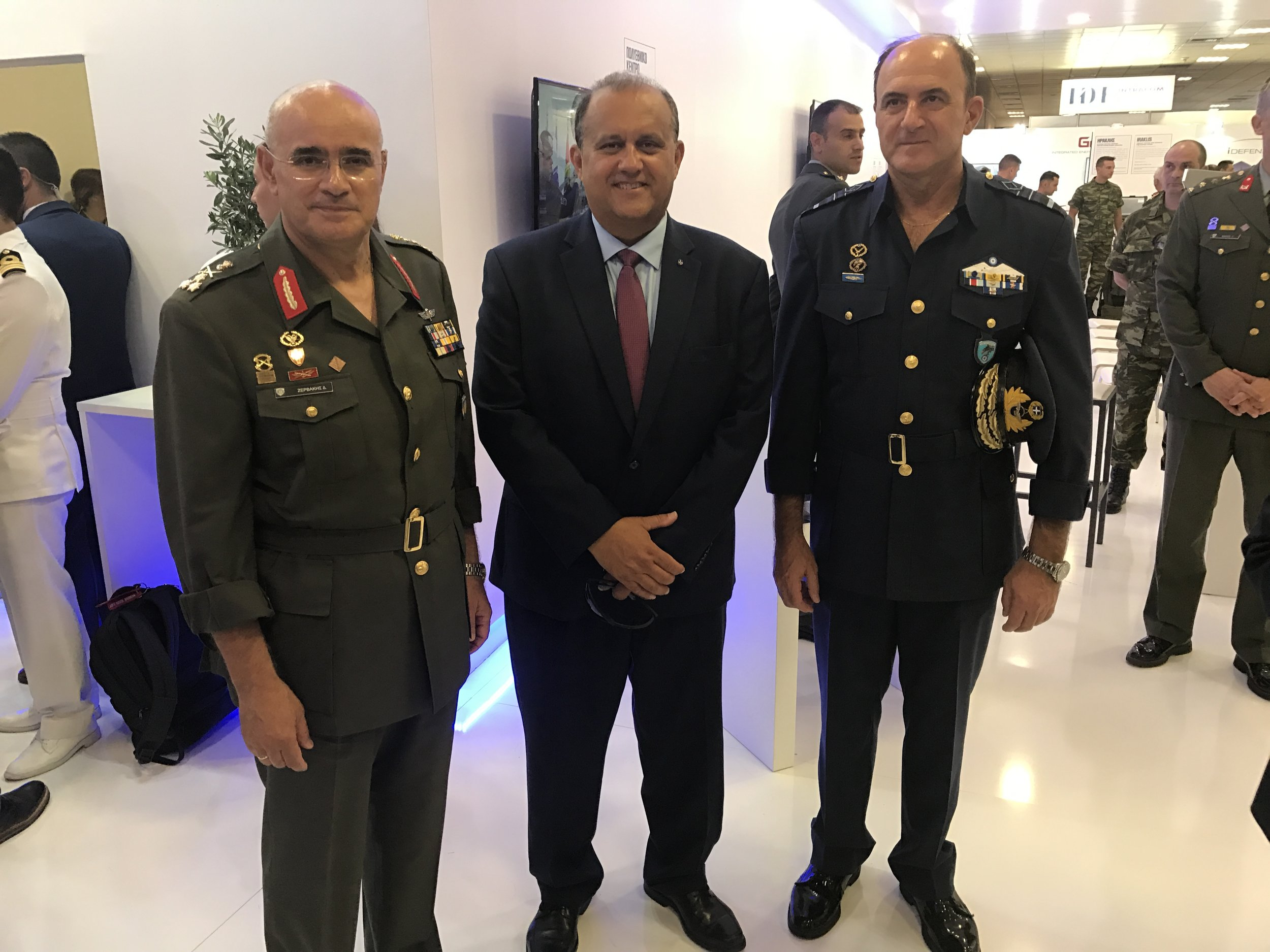 Nick Larigakis inside the Hellenic Armed Forces pavilion with (L) Lt. General Dimokritos Zervakis, Commander of the Hellenic First Army and (R), Lt. General Georgios Blioumis, Chief of Hellenic Tactical Air Force.