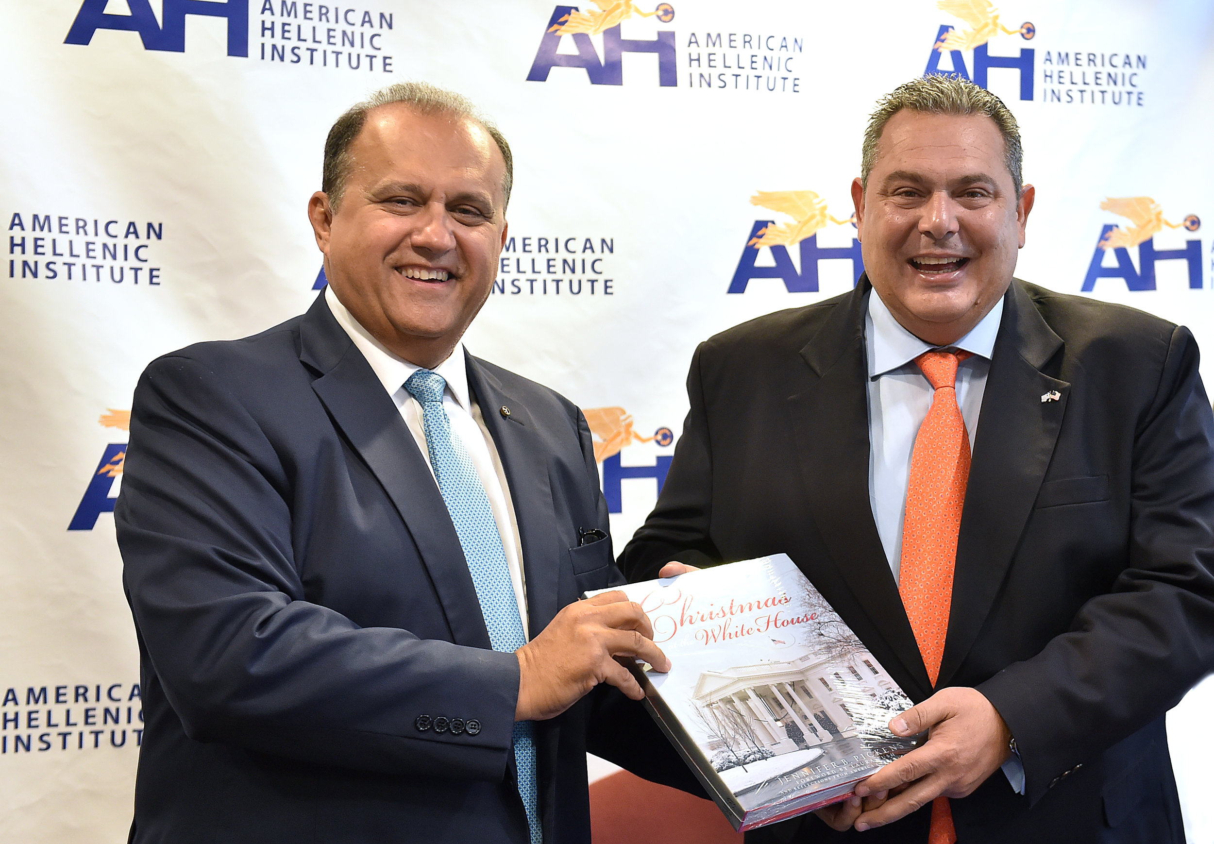 Nick Larigakis presents Minister Kammenos with a gift from the White House Historical Society.