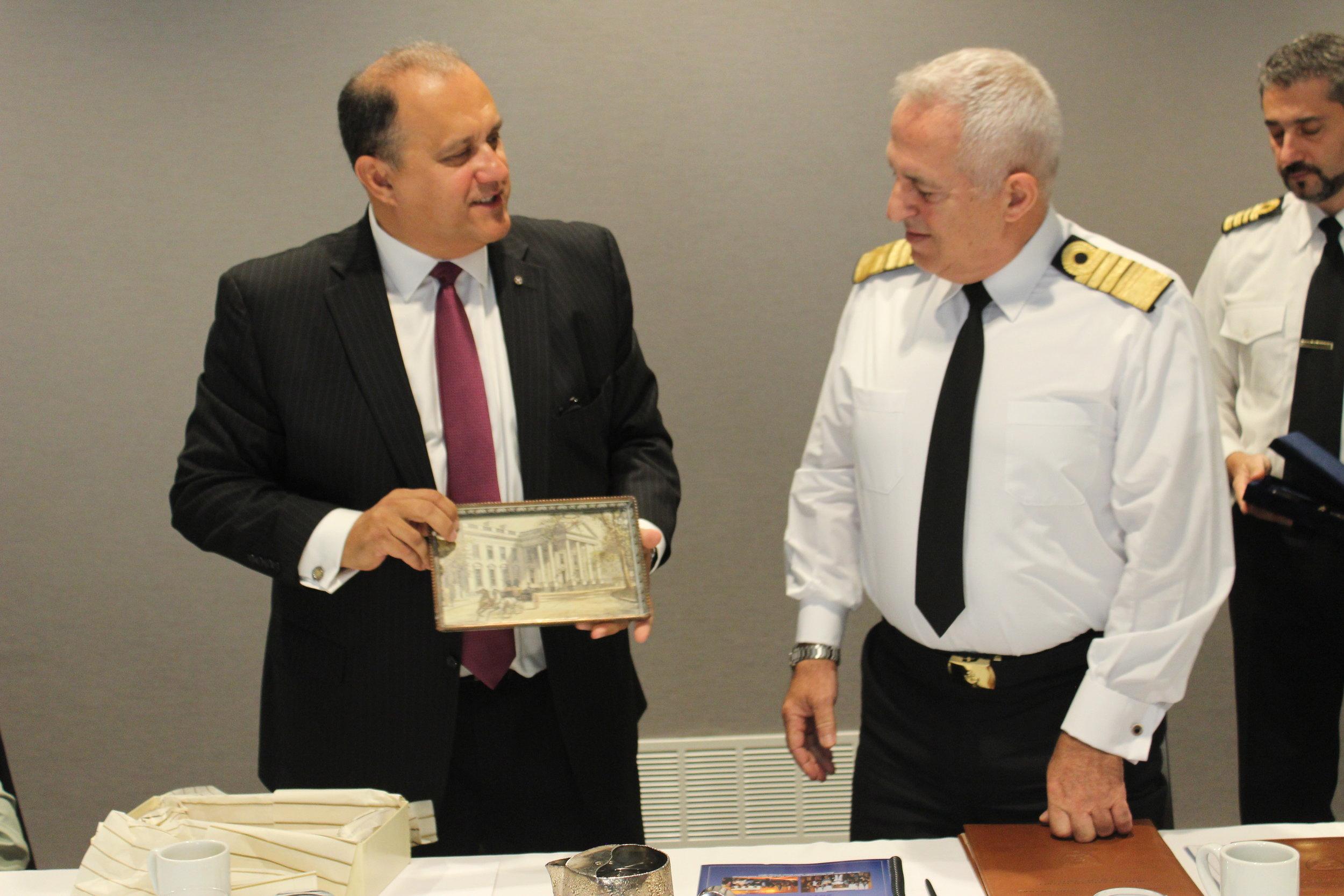 Nick Larigakis provides Admiral Apostolakis with a memento.