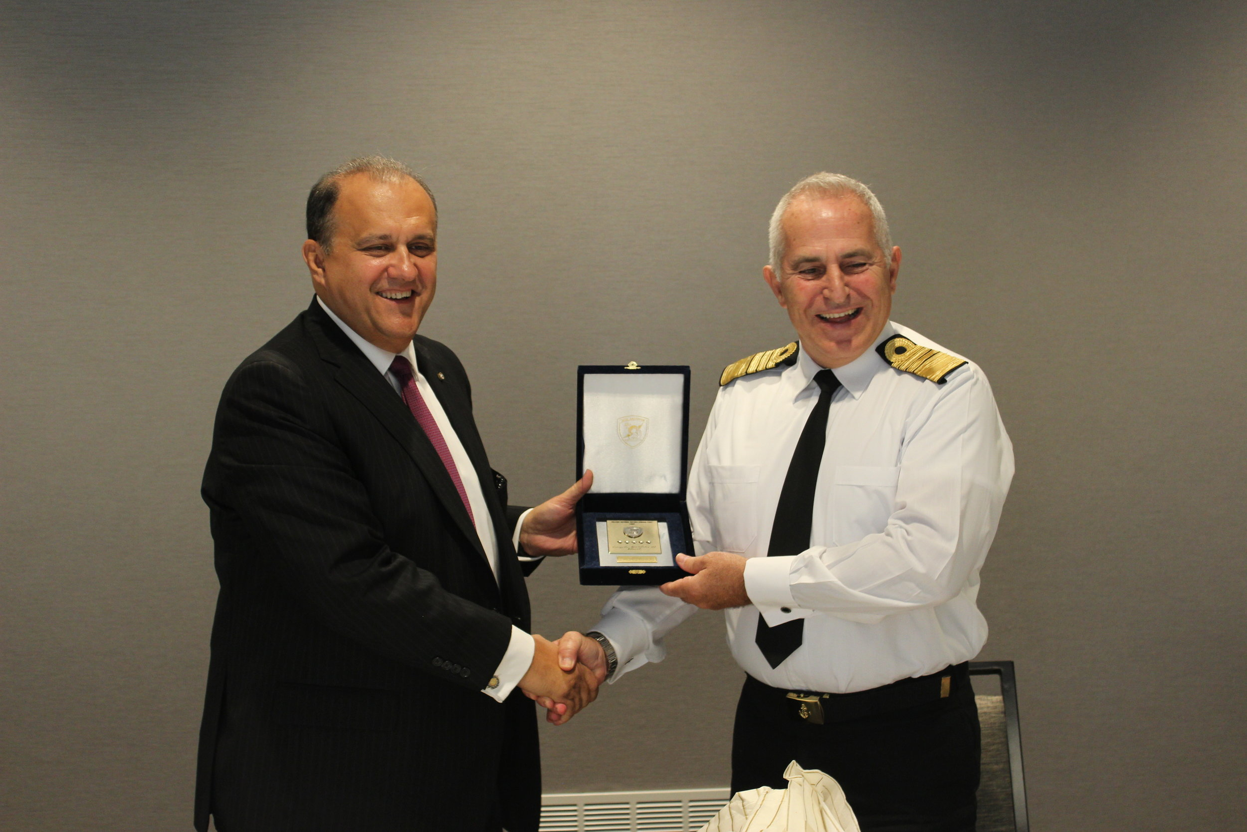 Admiral Apostolakis provides Nick Larigakis with a memento.