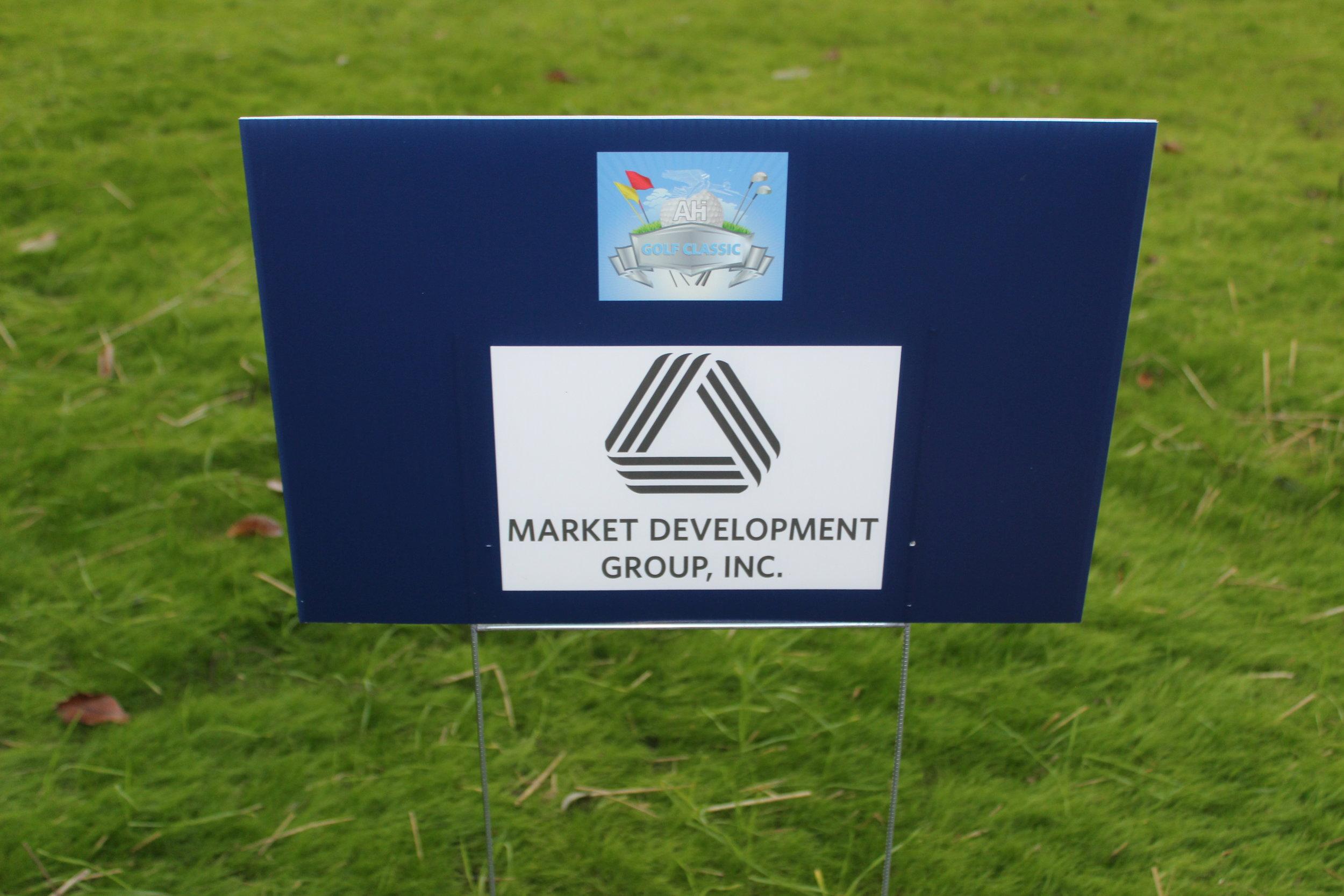 Market Development Group, Golf Cart Sponsor.