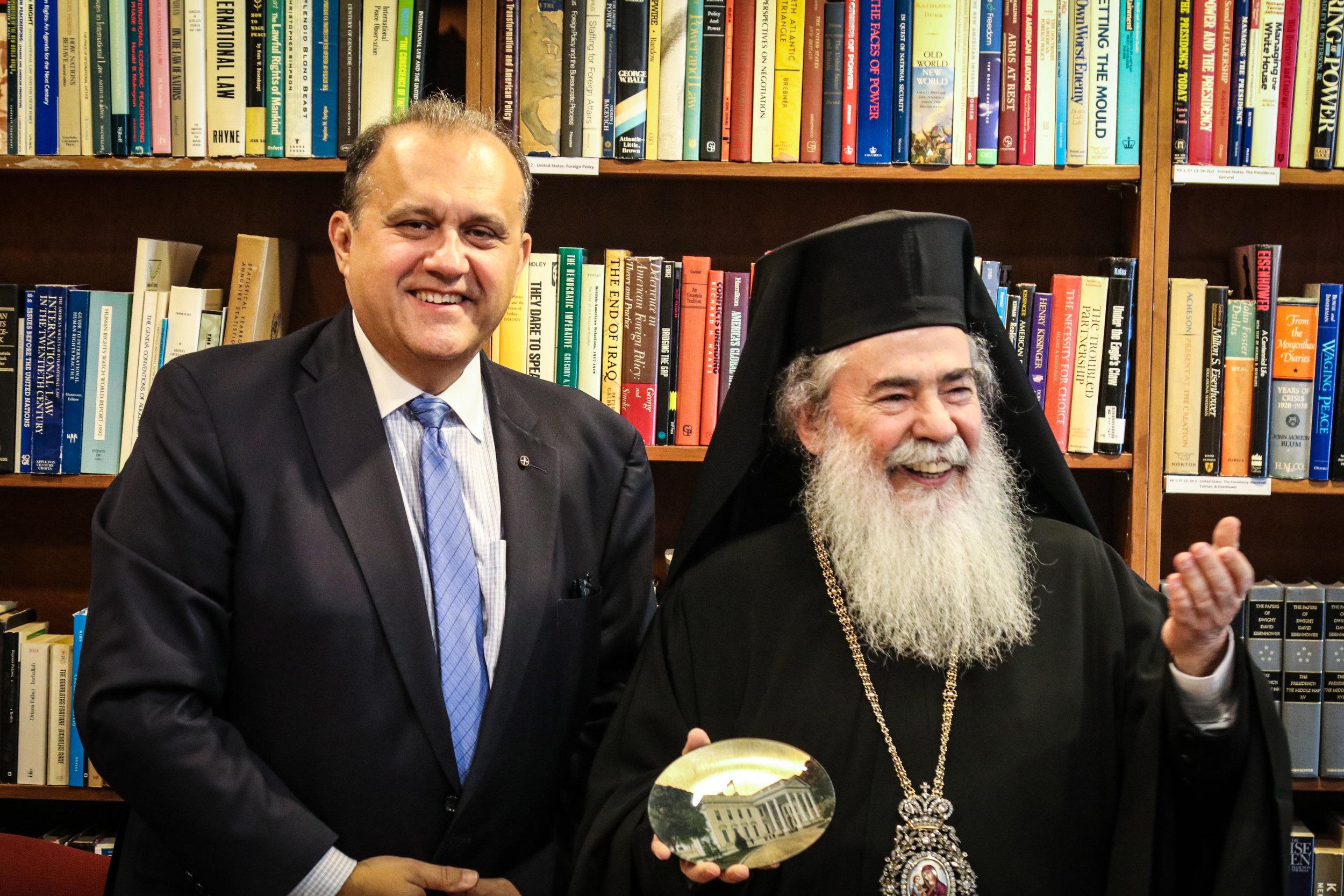 Nick Larigakis presents a memento to Patriarch Theophilos III.