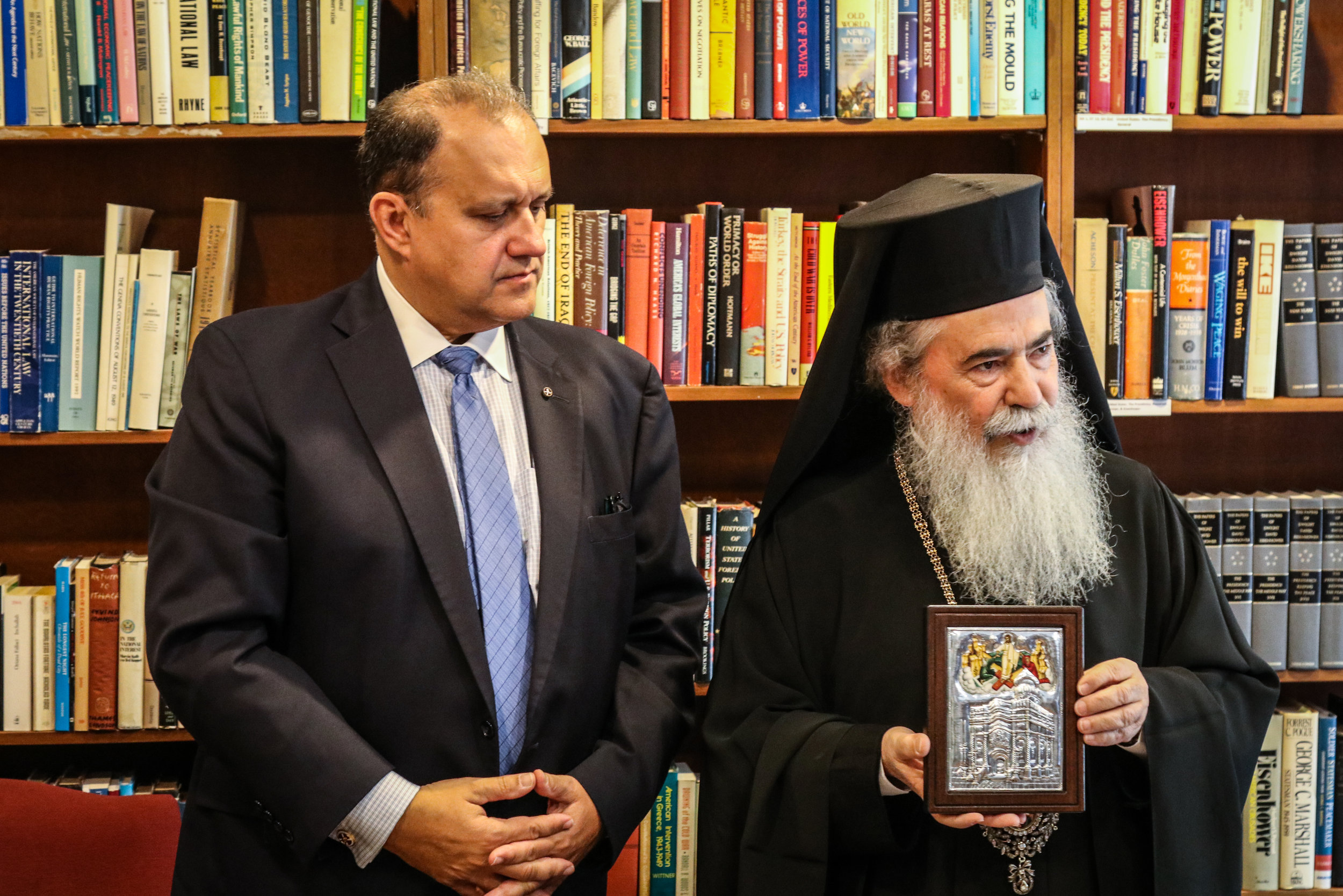 Patriarch Theophilos III presents Nick Larigakis with an icon of the Holy Sepulchre.