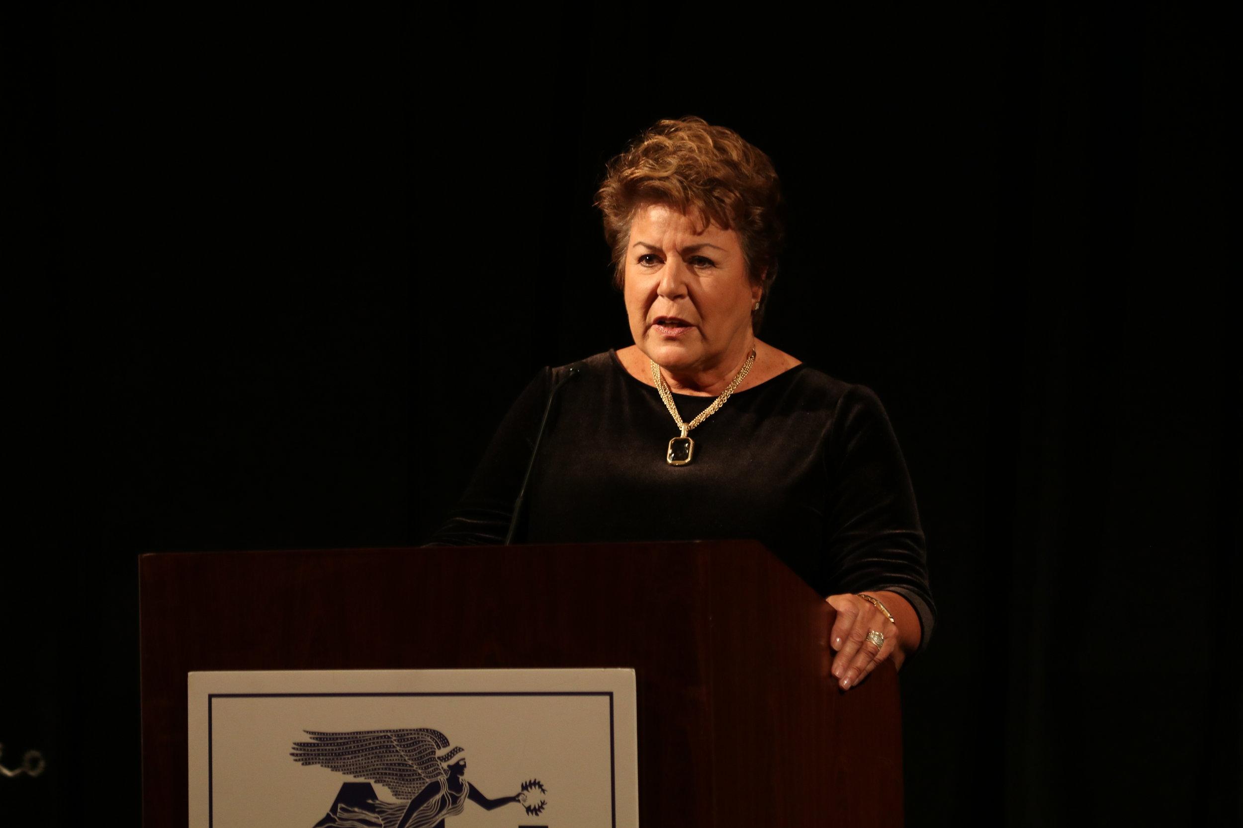 Award recipient Barbara Vittas provides accepting remarks.