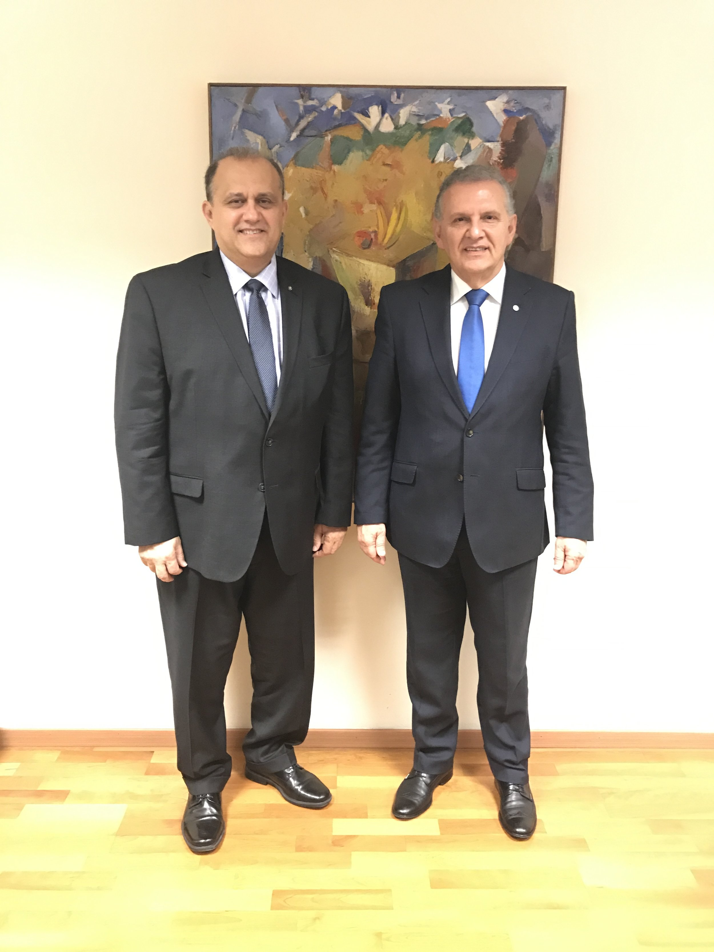 AHI President Larigakis (L) With Presidential Commissioner for Humanitarian Affairs and Overseas Cypriots Photis Photiou (R)