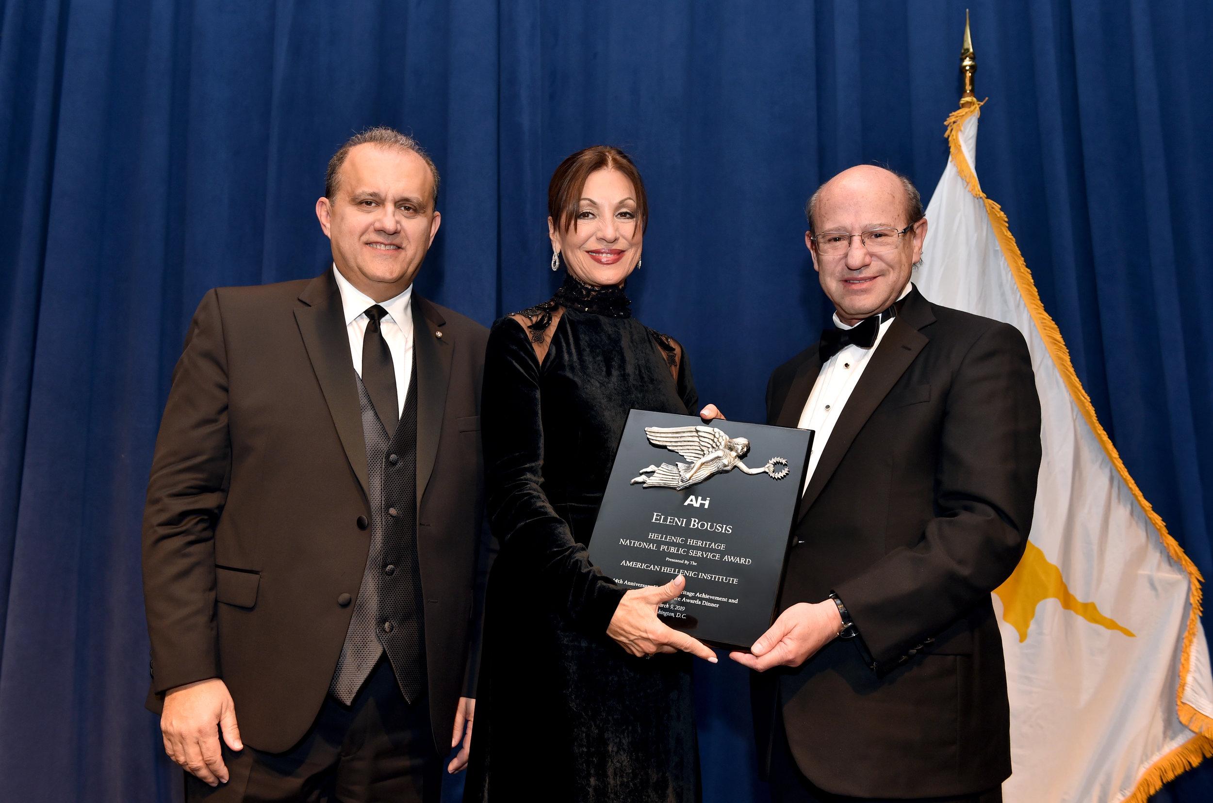 Eleni Bousis receiving the award from Nick Larigakis and Costas Galanis