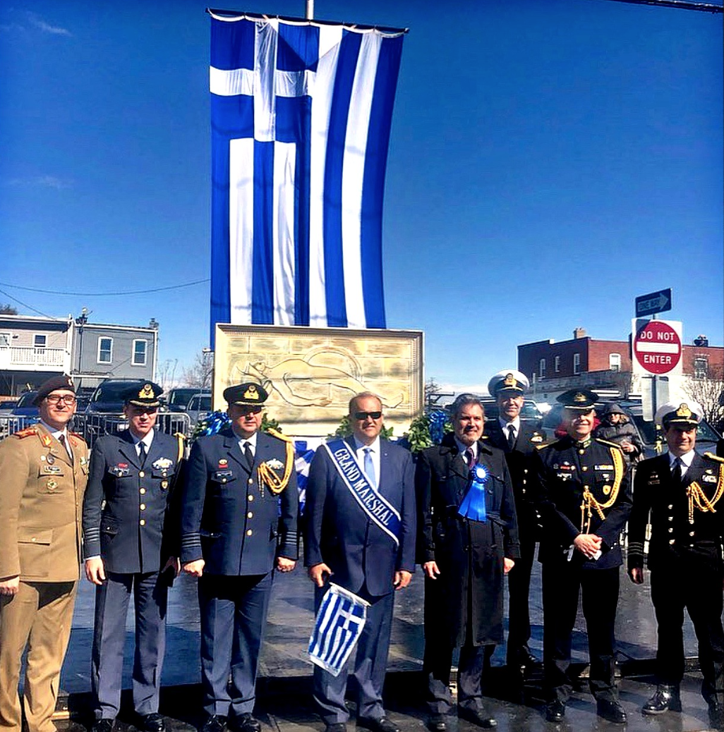 Nick Larigakis with Greek Ambassador to the U.S. Haris Lalacos (center) along with Greek military attaches of the Embassy of Greece in front of a representation of the Greek tomb of the unknown soldier
