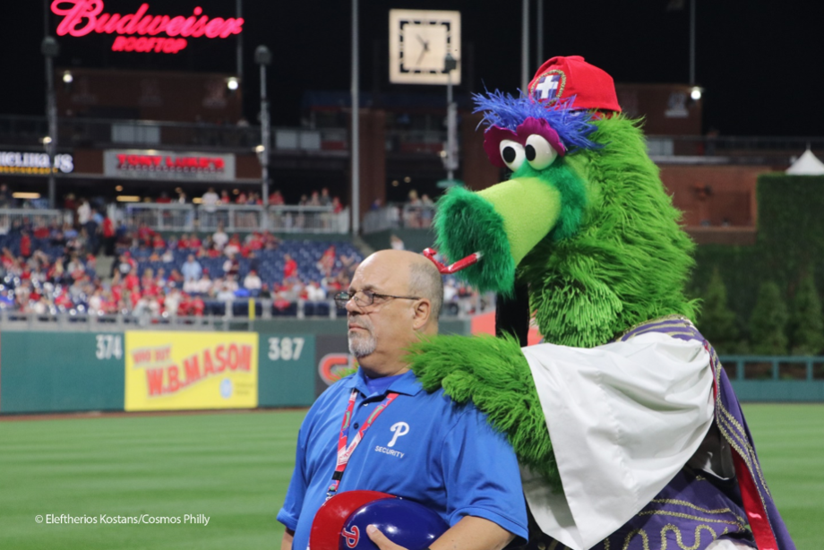 Philadelphia Phillies security official having fun with Phillies Phanatic in Evzone attire (courtesy of cosmosphilly.com)
