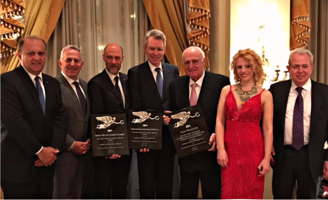 (L-R) Nick Larigakis, Minister of Defense Apostolakis, the American-Hellenic Chamber of Commerce, represented by President Simos Anastasopoulos, Geoffrey Pyatt, Ambassador of the United States to Greece, Ilias Malevitis, AHI Greece President Emeritus, AHI Board Member Dr. Athina Balta, evening Master of Ceremonies, and George Economou, Athens Chapter President