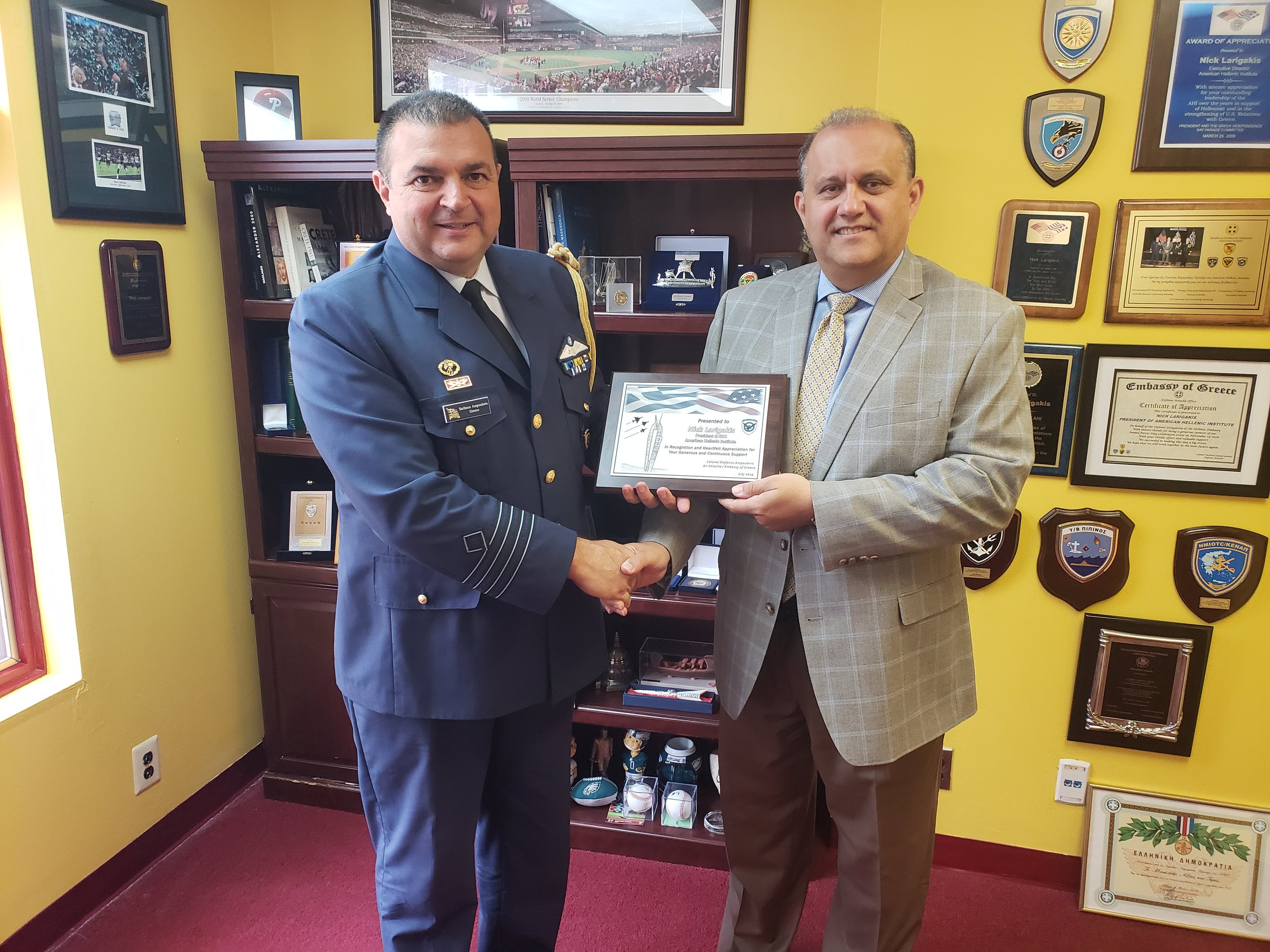(L-R) Col. Stefanos Ampouleris, Air attaché at the Embassy of Greece in Washington, D.C., bestowing citation to AHI President Larigakis