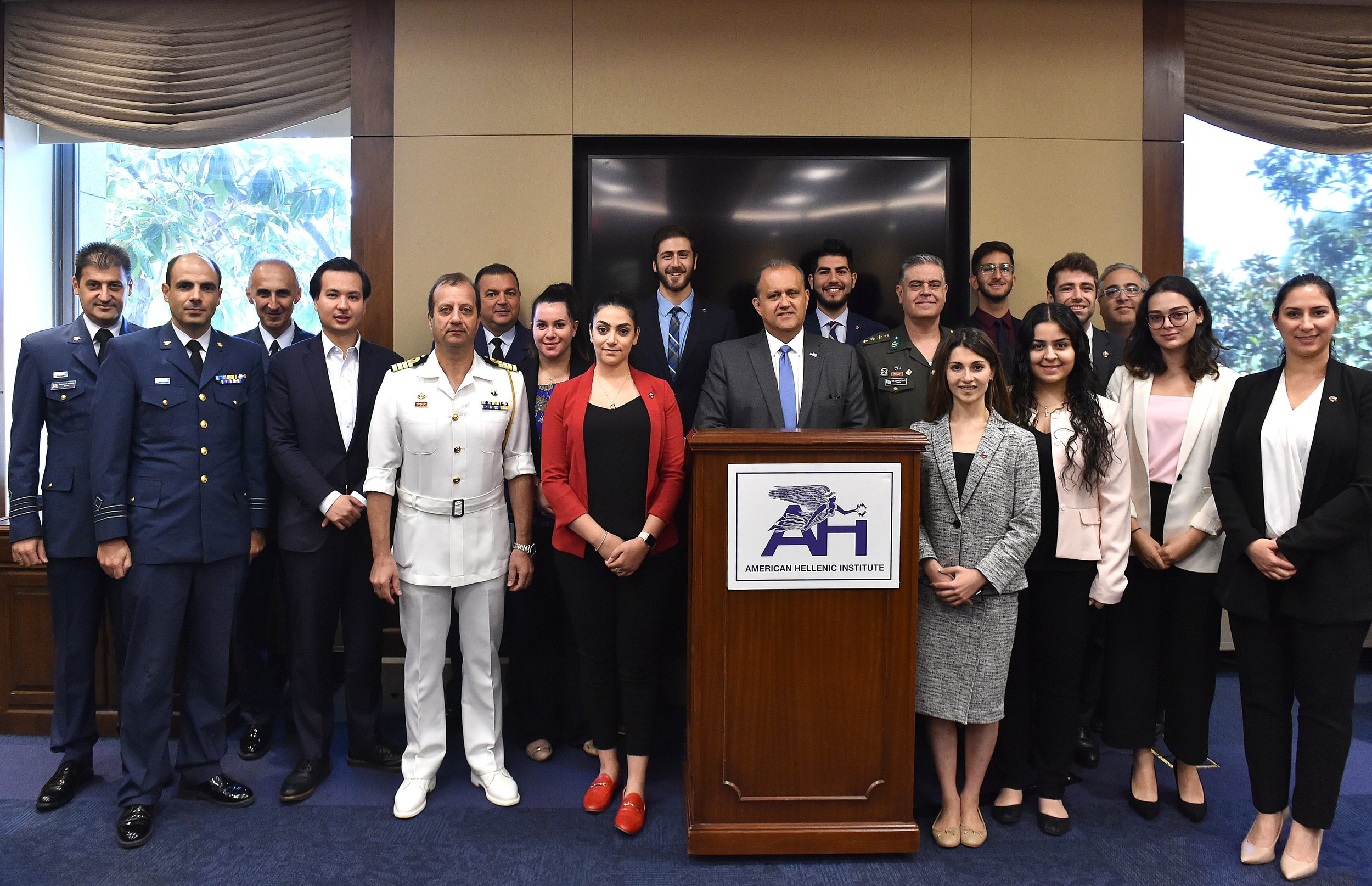 Group photo consisting of Greece's attaches and various military officials, AHI President Larigakis, Legislative Assistant Gerasoulis, and a delegation from the Armenian National Committee of America (ANCA)