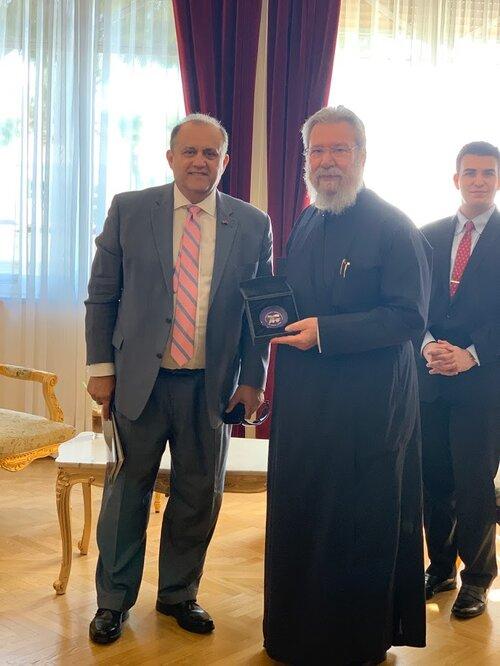 AHI President Larigakis presents His Beatitude, the Archbishop of Cyprus Chrysostomos II, with a commemorative memento