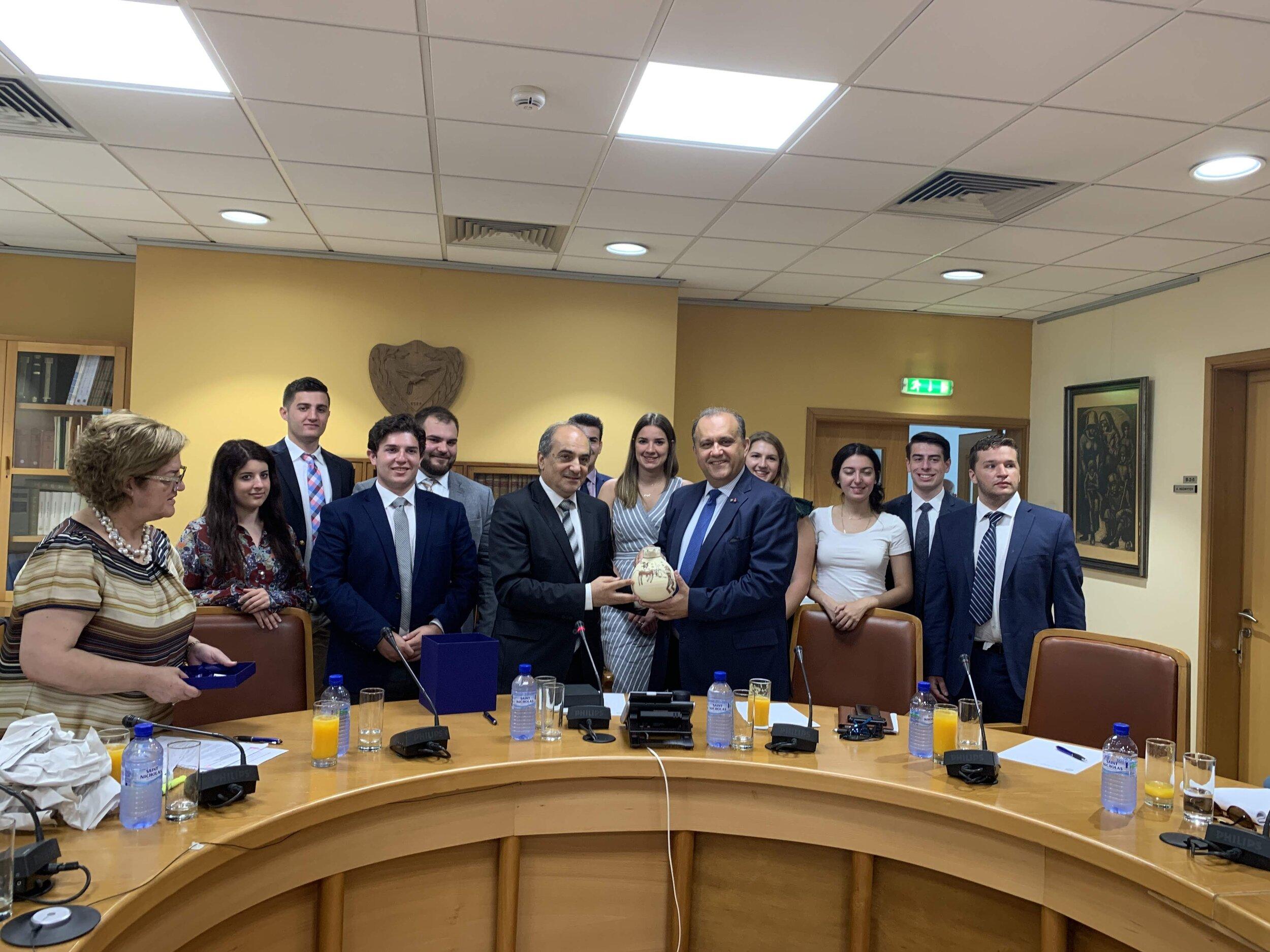 President of the House of Representatives Demetris Syllouris presents AHI President Larigakis with a commemorative momento