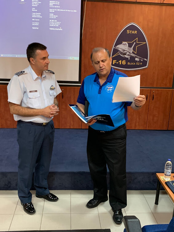 AHI President Nick Larigakis sharing AHI's policy papers with Colonel Evangelos Tzikas at HAF 115 Combat Wing