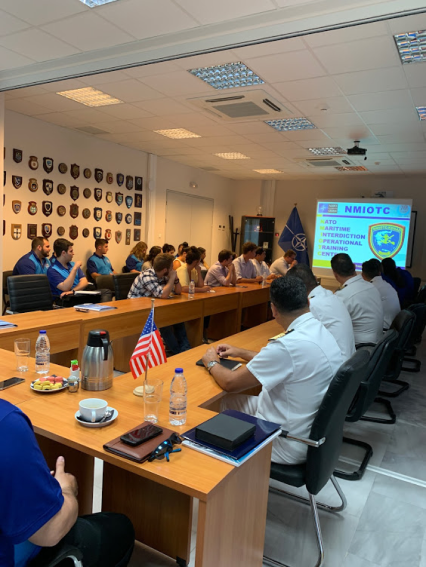 Receiving briefing at NATO Maritime Interdiction Operational Training Center (NMIOTC)