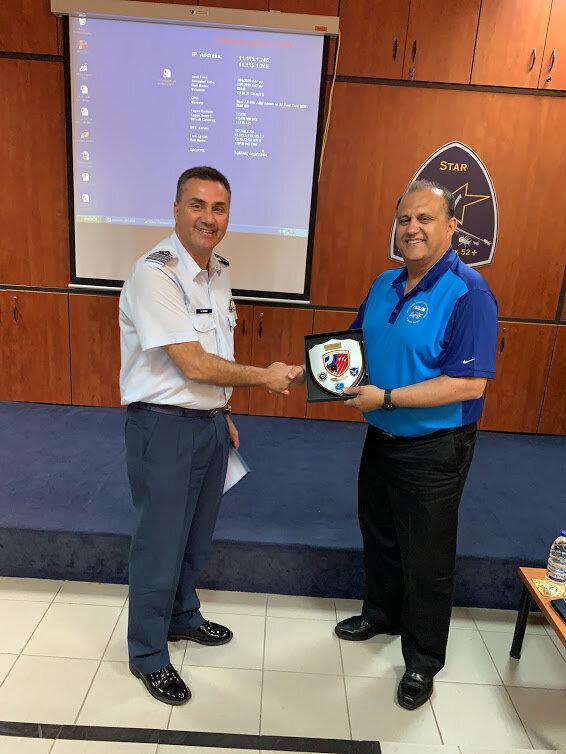 AHI President Nick Larigakis receiving commemorative memento from Hellenic Air Force 115 Combat Wing Colonel Evangelos Tzikas