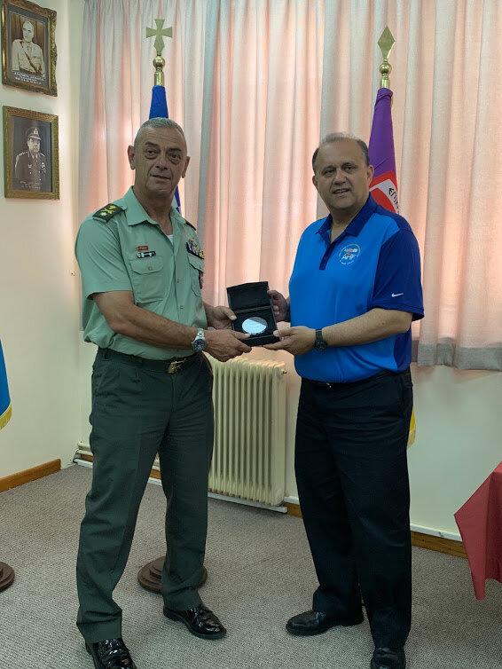 AHI President Nick Larigakis presenting 5th Mech. Brigade Commander, Brigadier Stylianos Gasparakis with commemorative memento