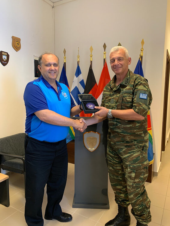 President Nick Larigakis presenting NAMFI Commander Kleanthis Karatsin with commemorative memento