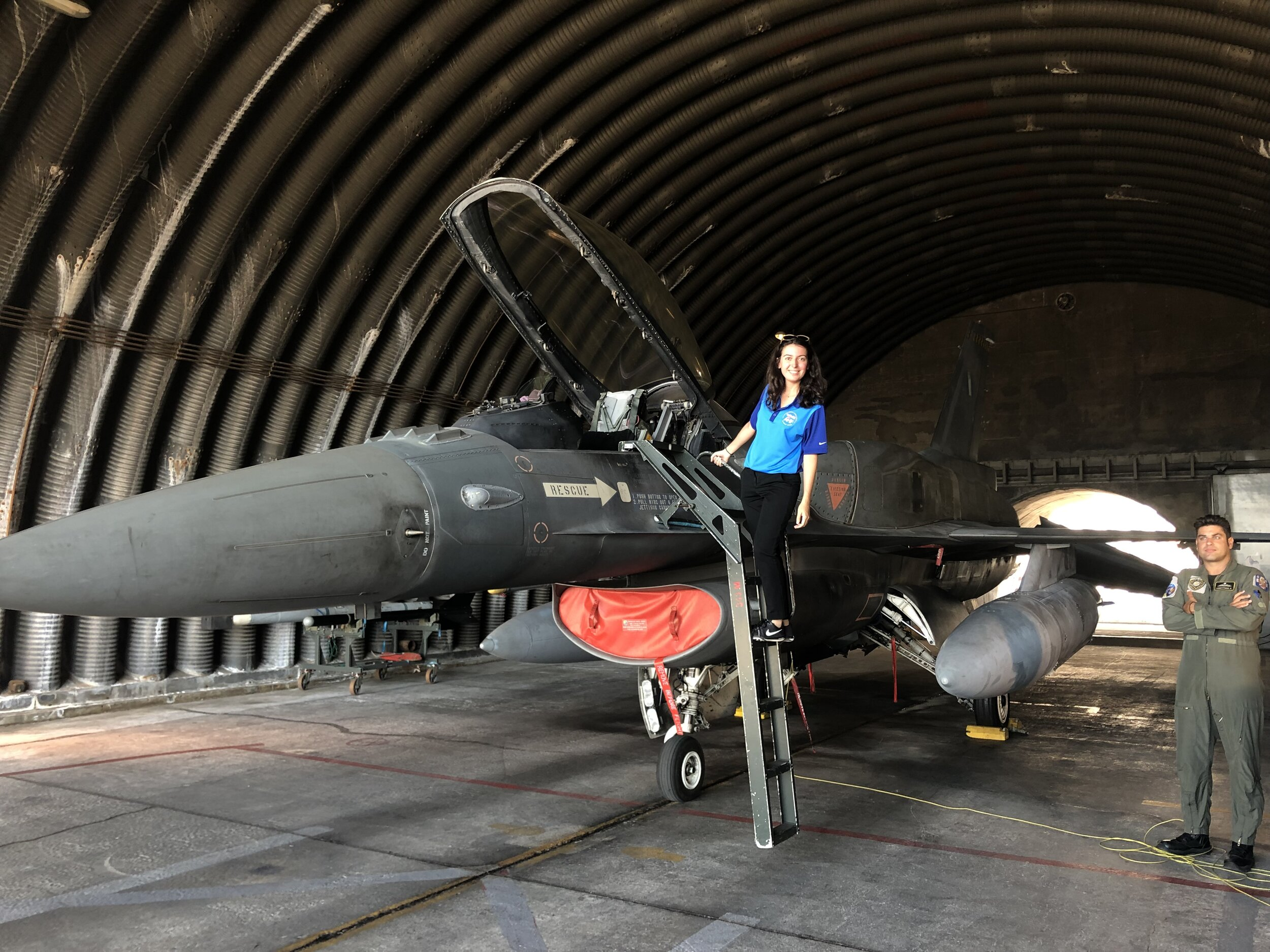 Student Alexandra Choate posing with a F-16