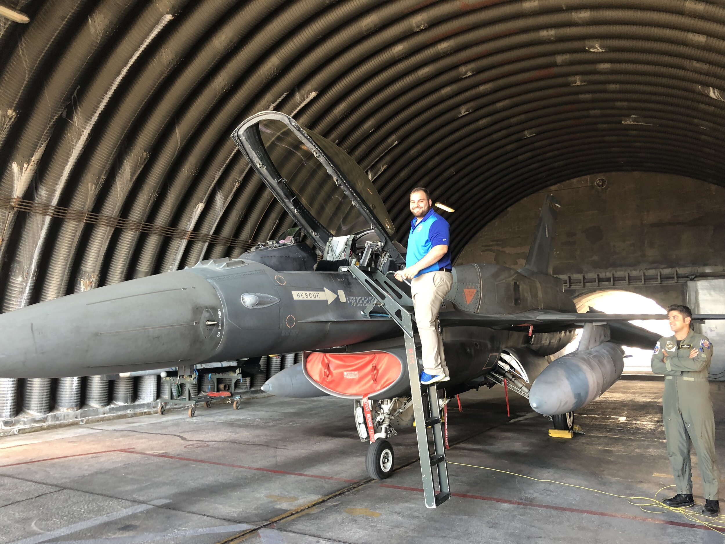 Student Demosthenes Theofanopoulos posing with a F-16