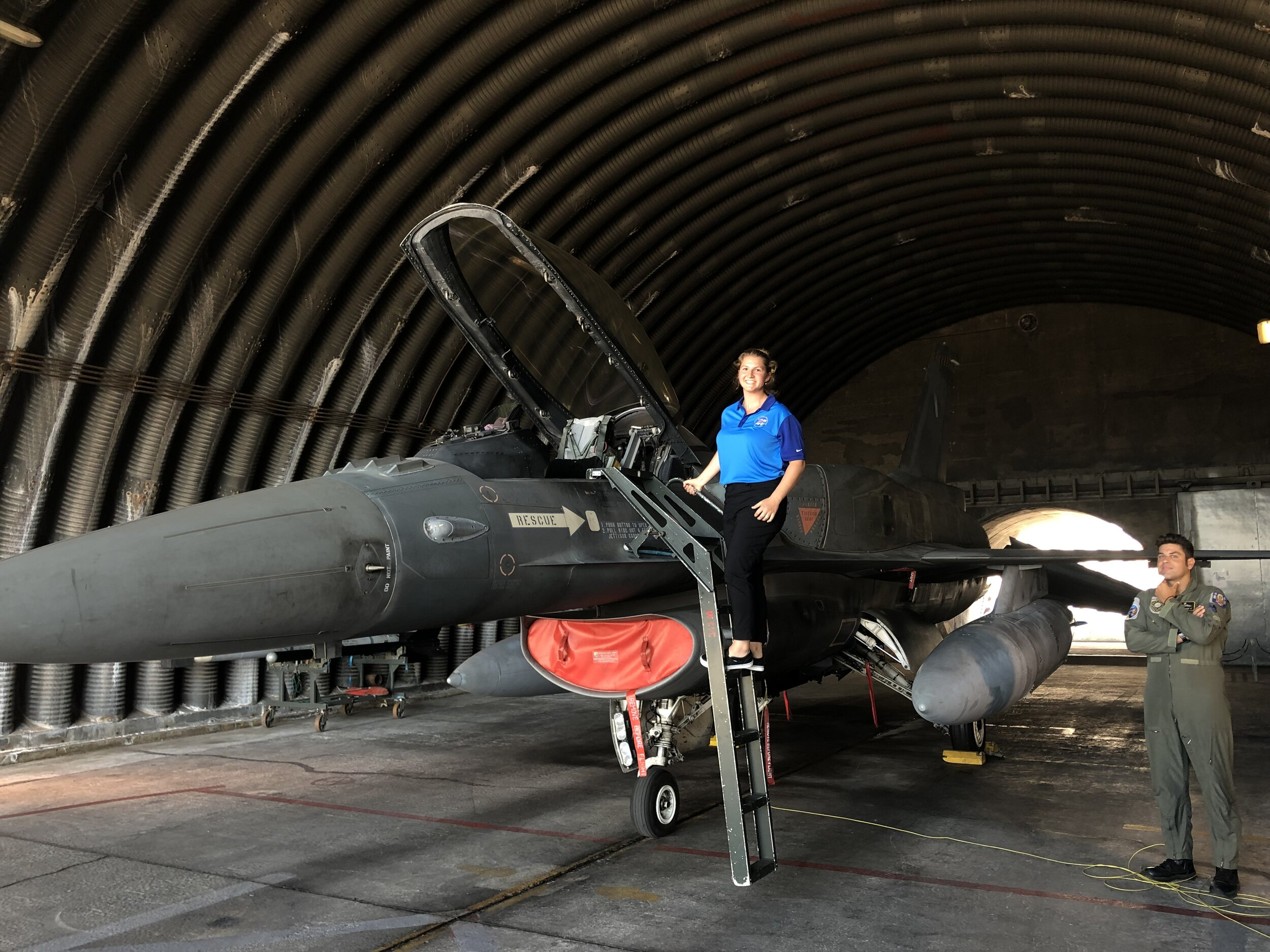 Student Sophia Yphantides posing with a F-16
