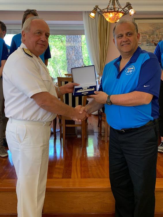 AHI President Nick Larigakis receiving commemorative memento from Fleet Commander Vice Admiral Stylianos Petrakis in Salamis Naval Base