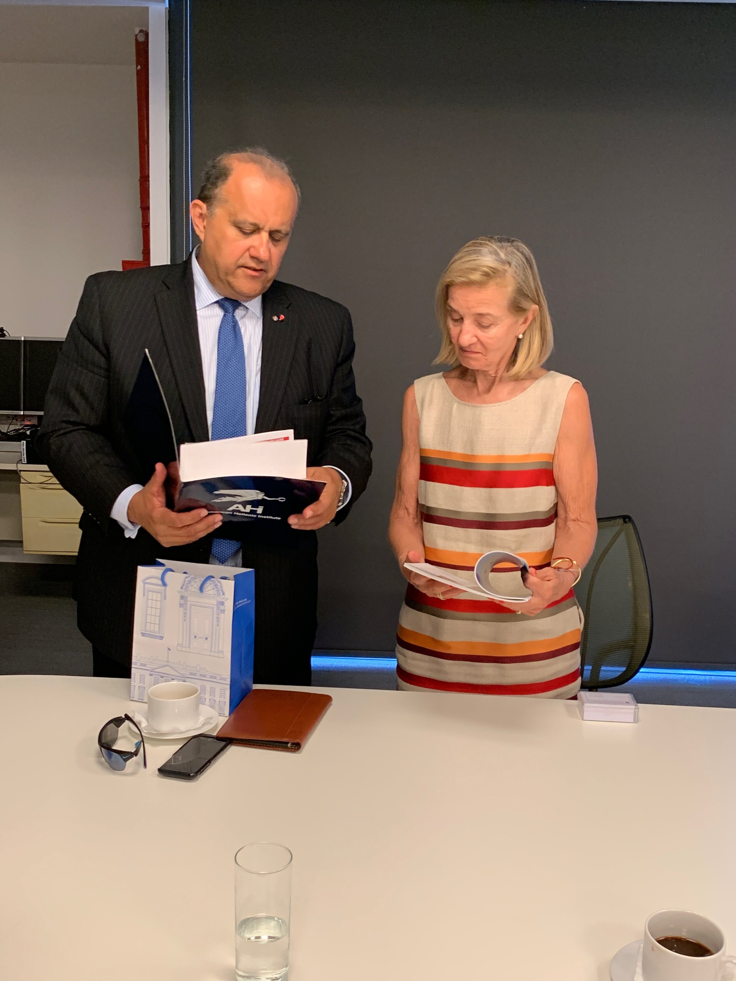 AHI President Nick Larigakis sharing AHI's policy papers with Mrs. Marina Martinou