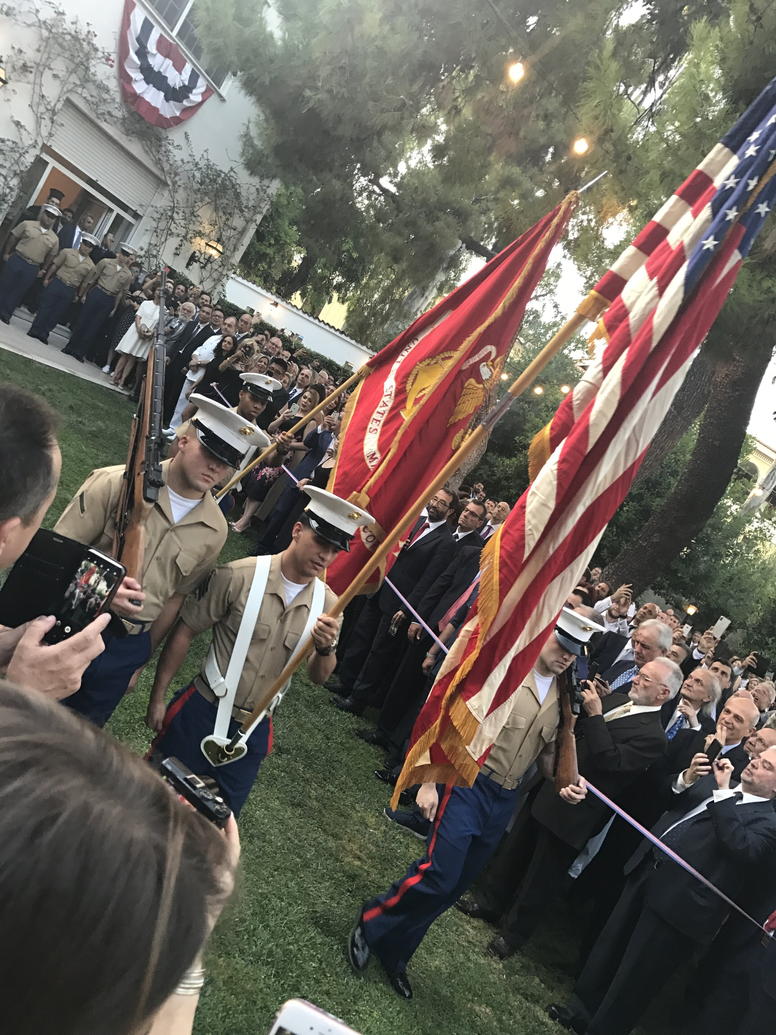 The Color Guard carrying the Colors at the 4th of July Reception at the U.S. Ambassador's Residence