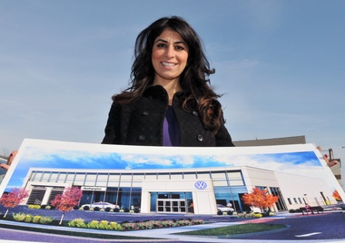 Carla Cosenzi, president of the Tommycar Auto Group, shows an artist's rendering of what will be her new Northampton Volkswagen dealership on King Street.