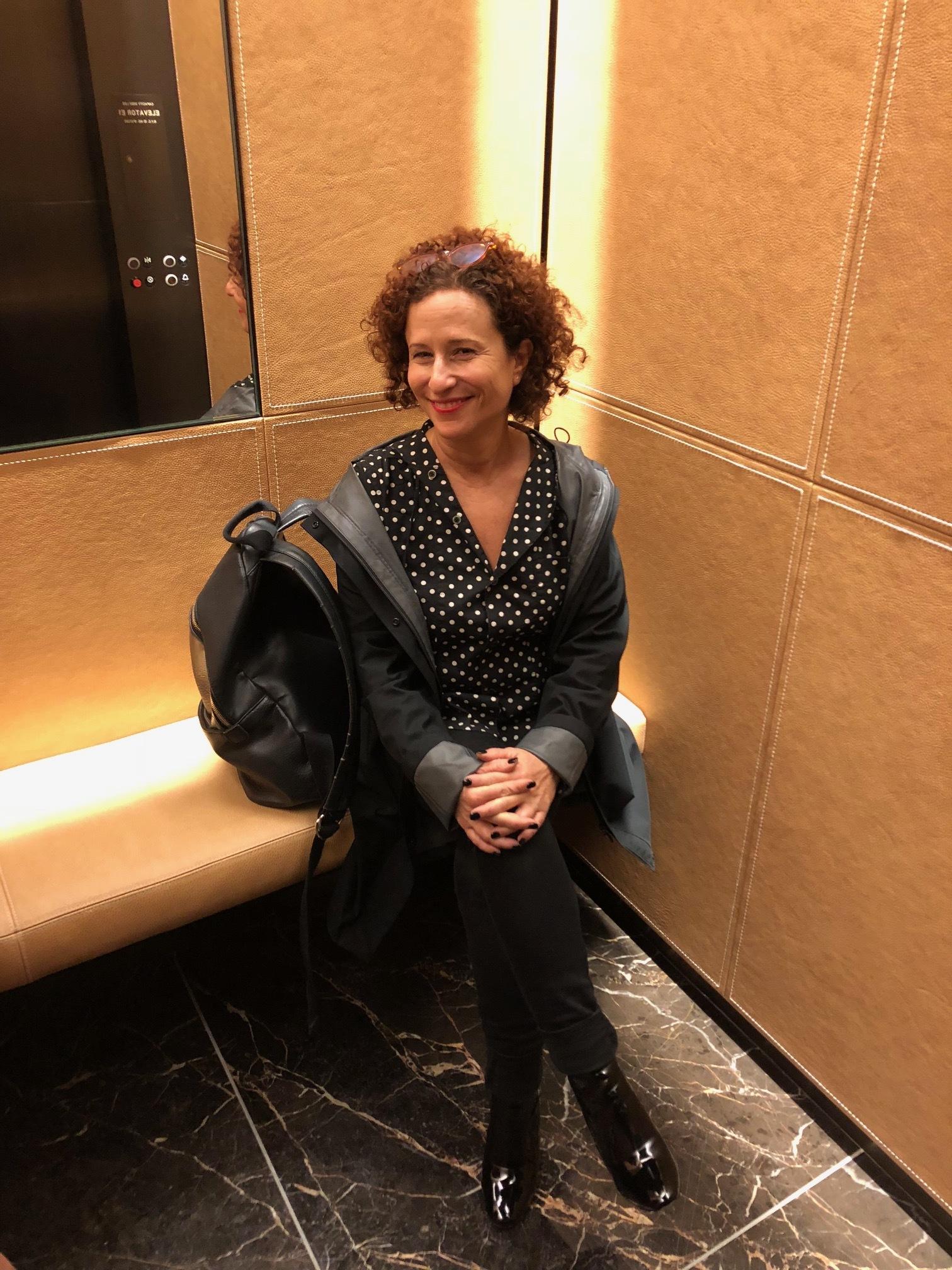 Team member Joan Schaffer tries the elevator bench in 432 Park