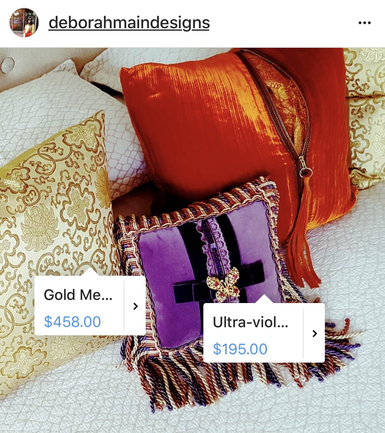 Screenshot 1, showing the product tags that Deborah has added to her luxury pillows on her Instagram feed at http://instagram.com/deborahmaindesigns.