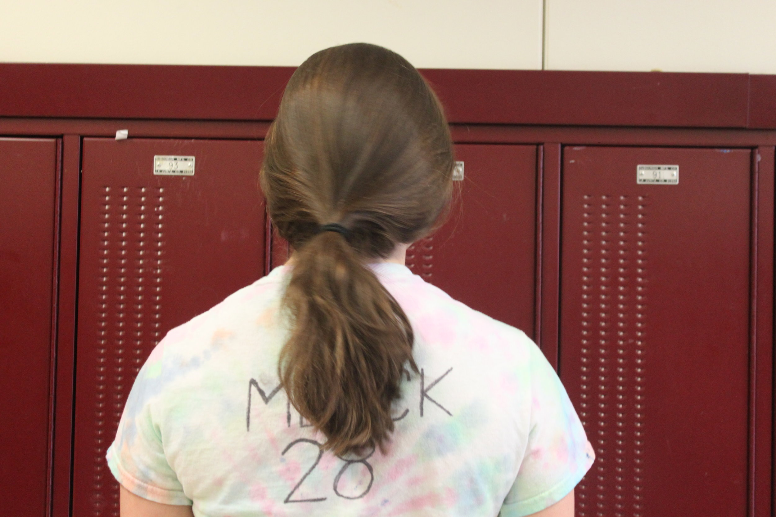 Kathryn Merck runs in place with a tye dye shirt and then…