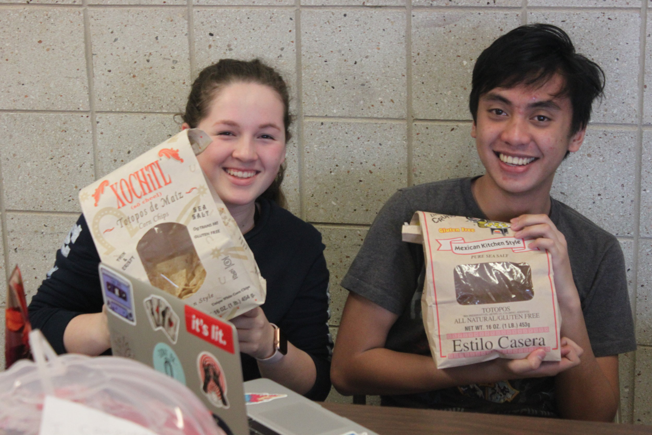 """Andrea Prest and Resty Fufunan hold up tortilla chips as they prepare for """"Hurricane Tortilla."""""""