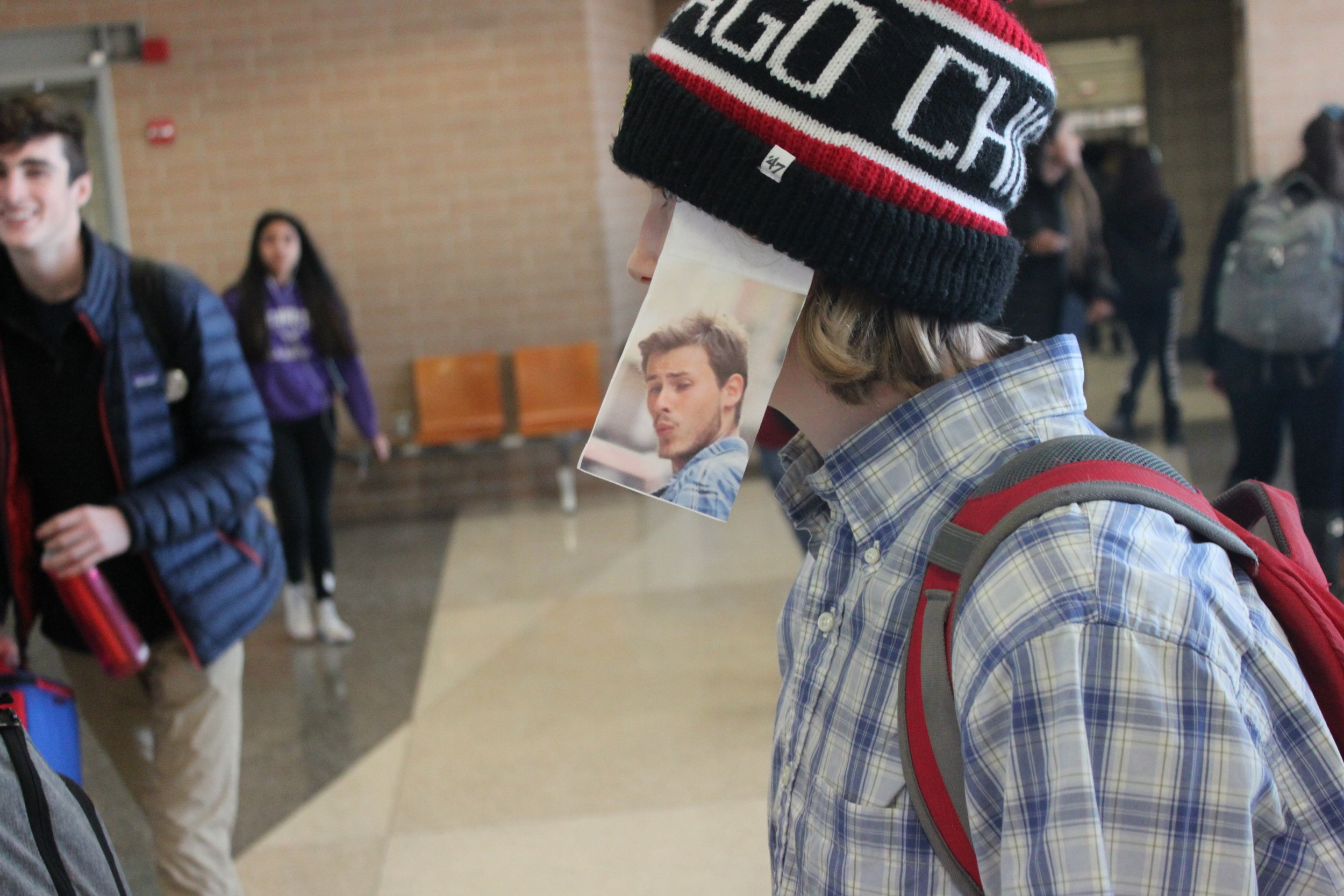 This student taped the meme he was interpreting to his hat.