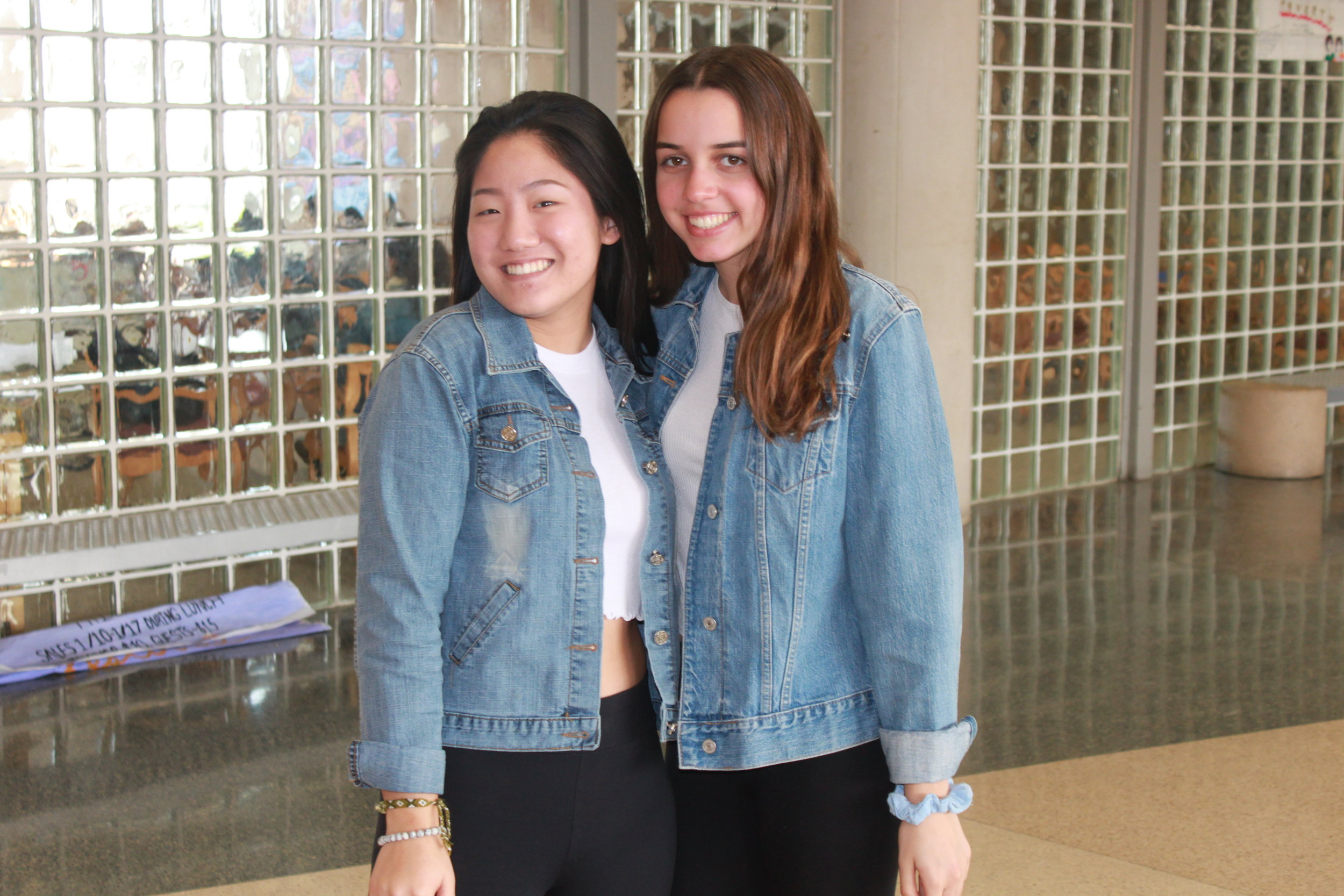 Christina Yoon and Isabella McLaughlin wear jean jackets and top the look of with scrunchies on their wrists!