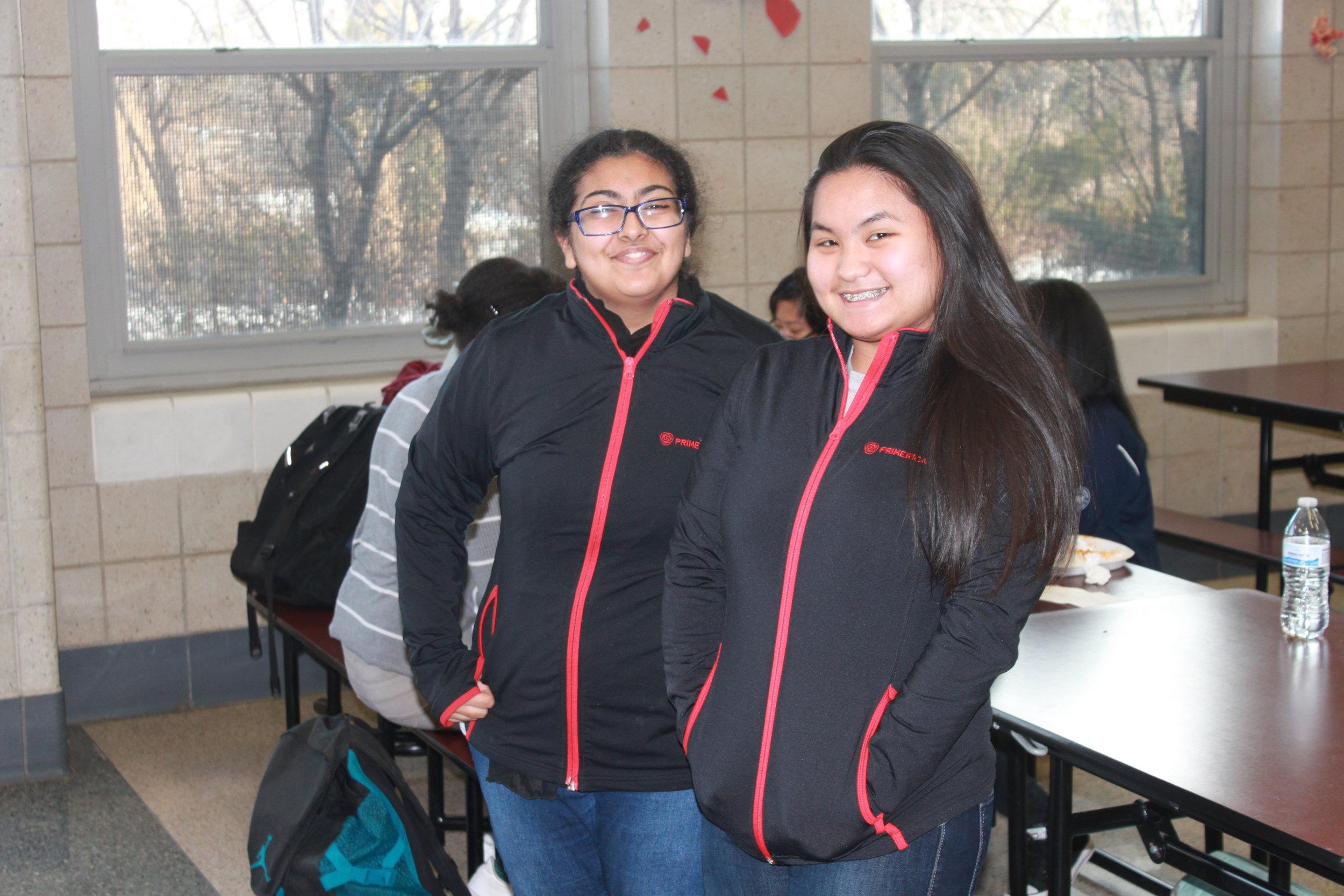 Engelica Santillian and Assma Ali wear matching black zip ups.