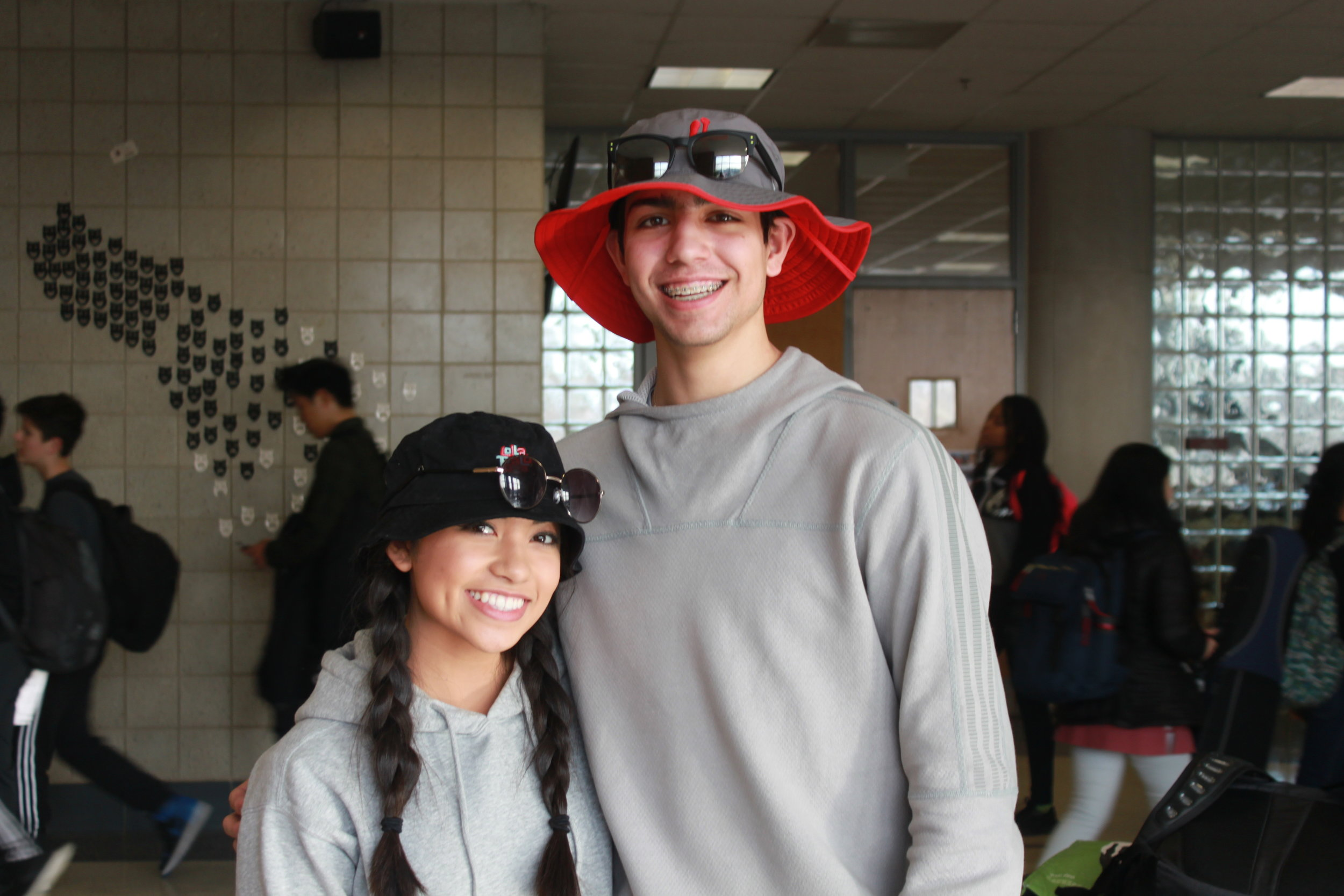 Ben Rosenguard and Eva Empleo wear bucket hats and sunglasses to top off their twin day look.
