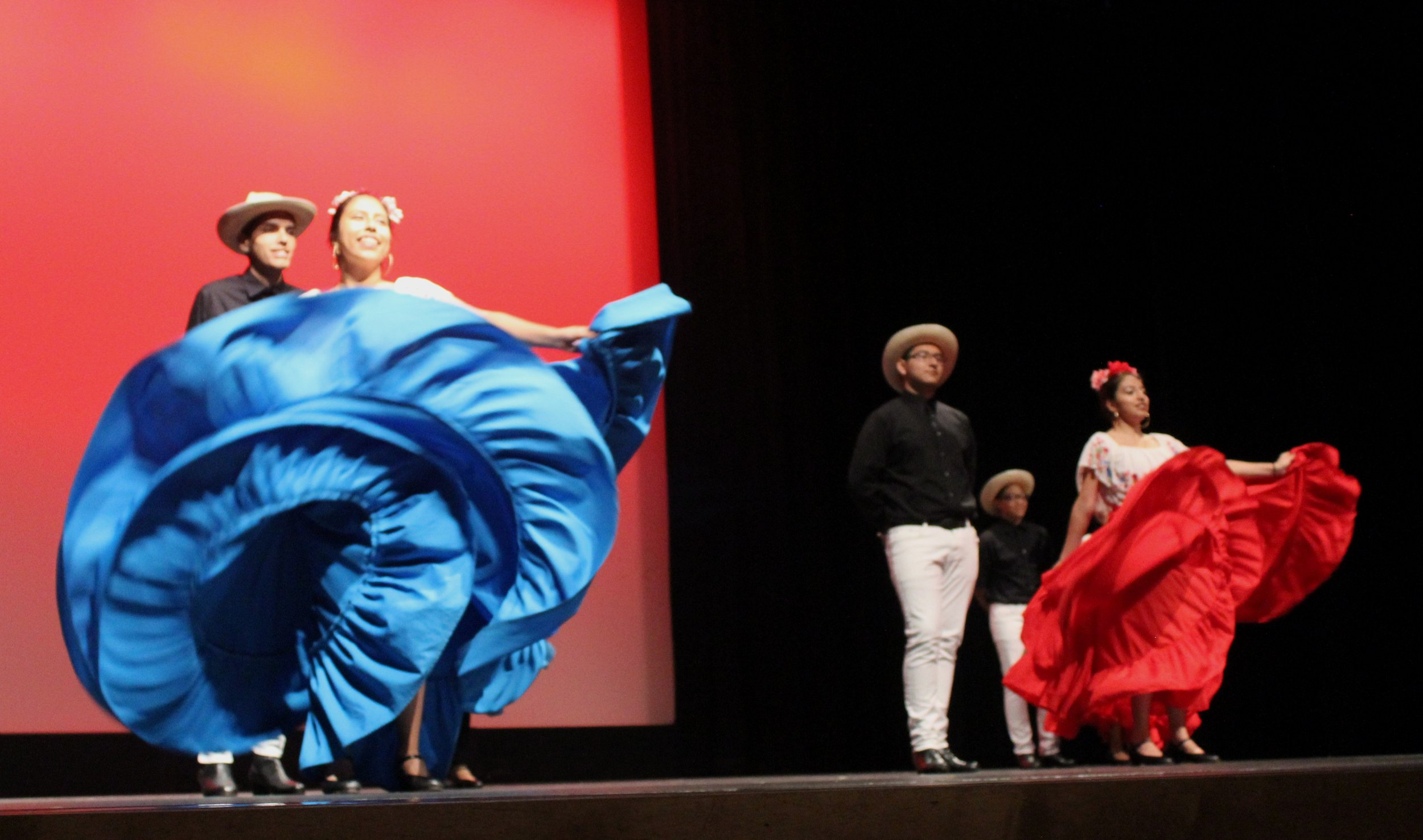 Folklorico dresses dancing in the air.