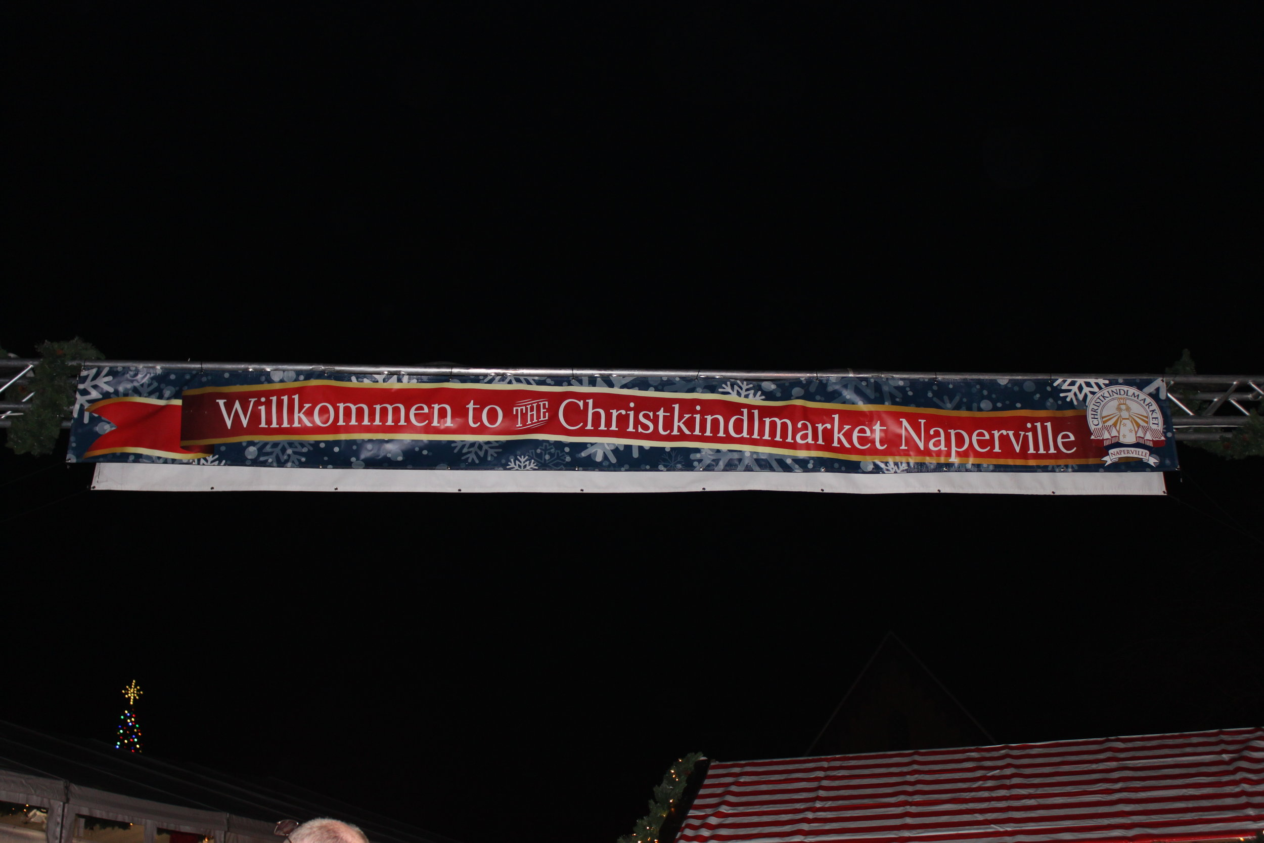 A banner welcomes visitors to the Kindlemart.