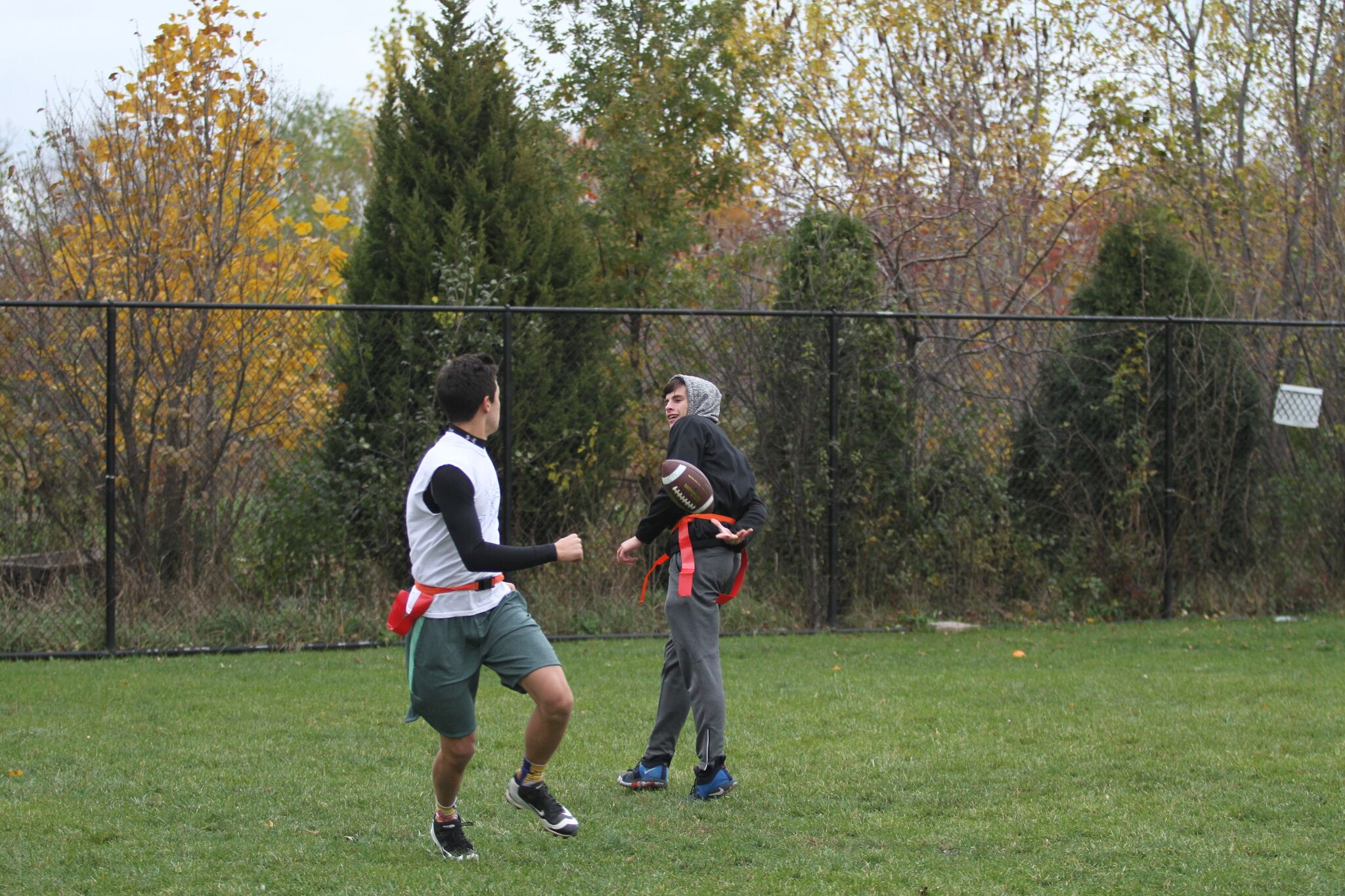 Jack Vasilopoulos, Adv. 006, tosses the ball to his teammate behind his back.