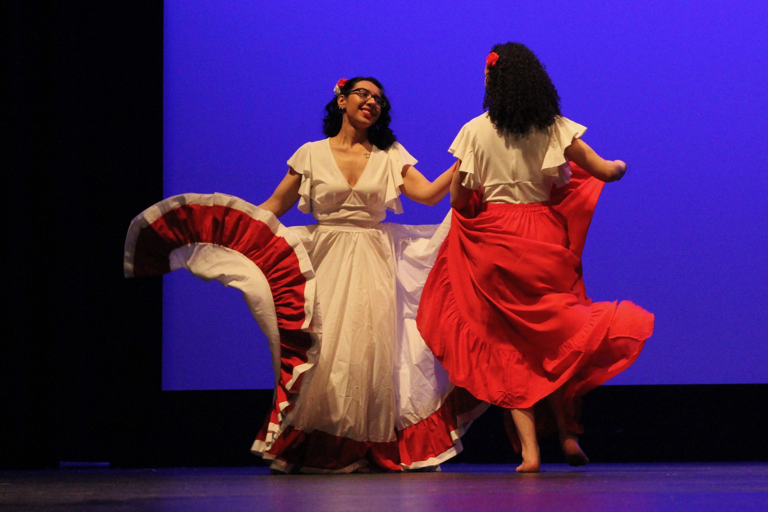 The Le Lo Lai women dazzle the audience with their elegant flowing skirts while dancing a Puerto Rican dance