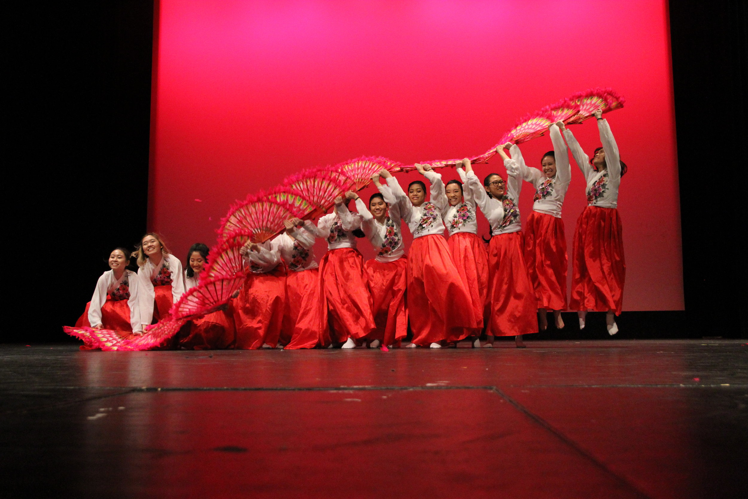 Korean Fan Dance creates a monstrous wave with their traditional red fans as gasps of awe erupt from the audience