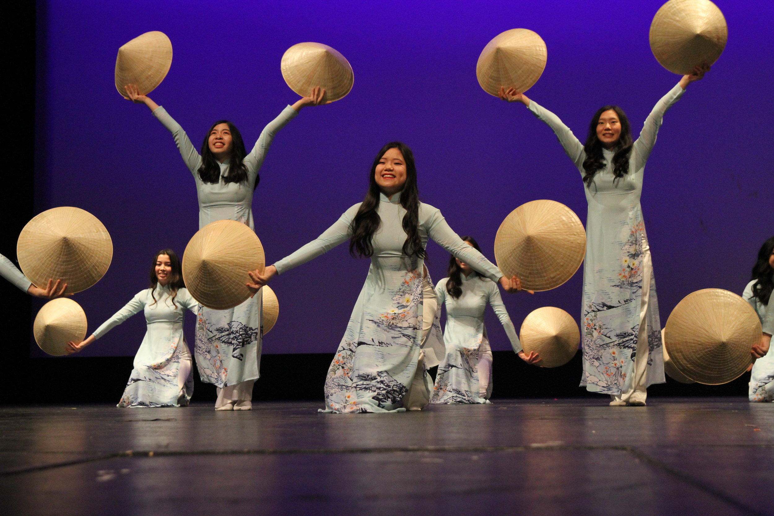 Grace Nelson, Adv. 908, and the remaining dancers of Viet Mua, hold their traditional Vietnamese hats with honor