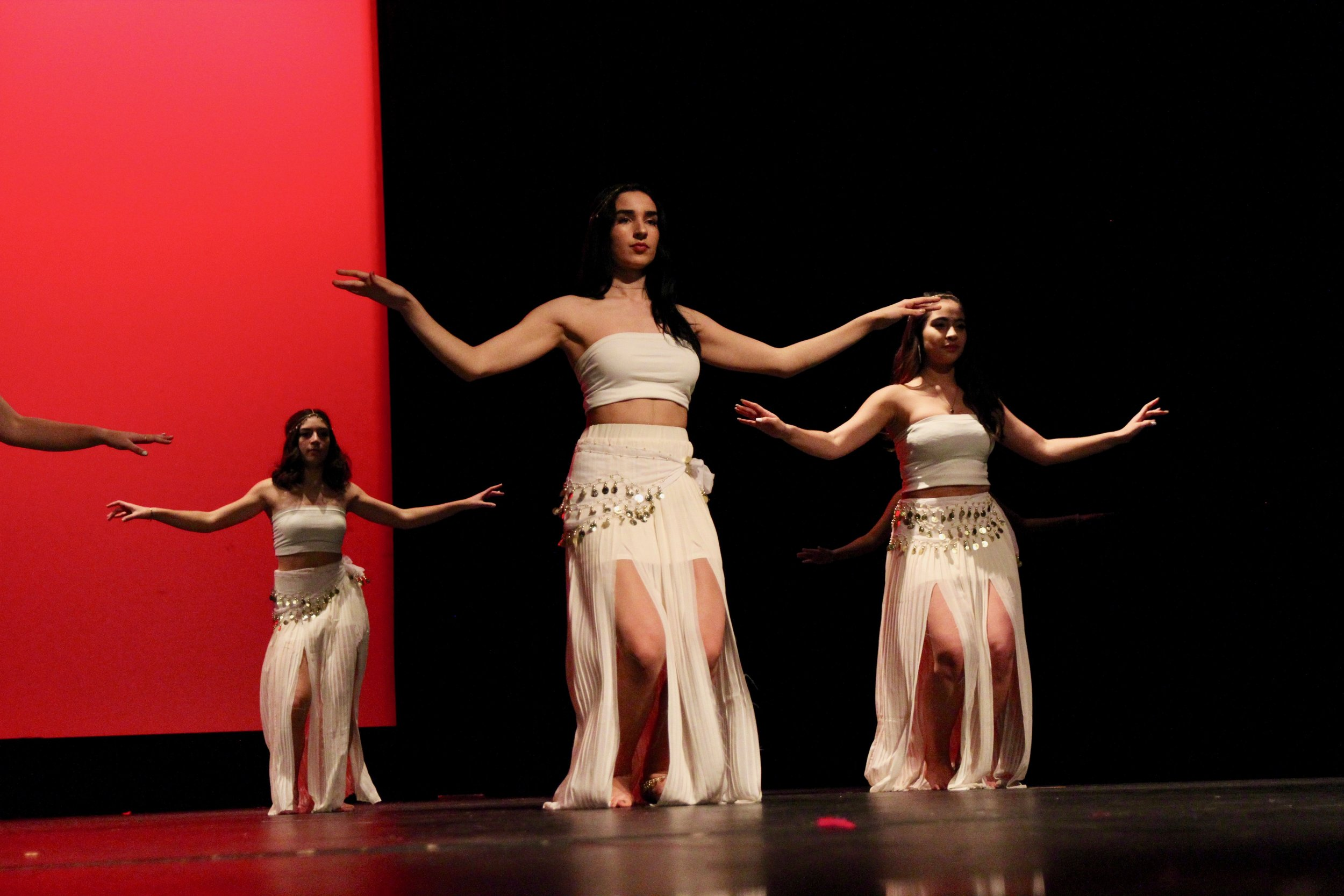 Sarah Kamal and Kiara Aldana, Adv. 902, shake their hips adorned with gold beads as they charm the audience with their sultry dance